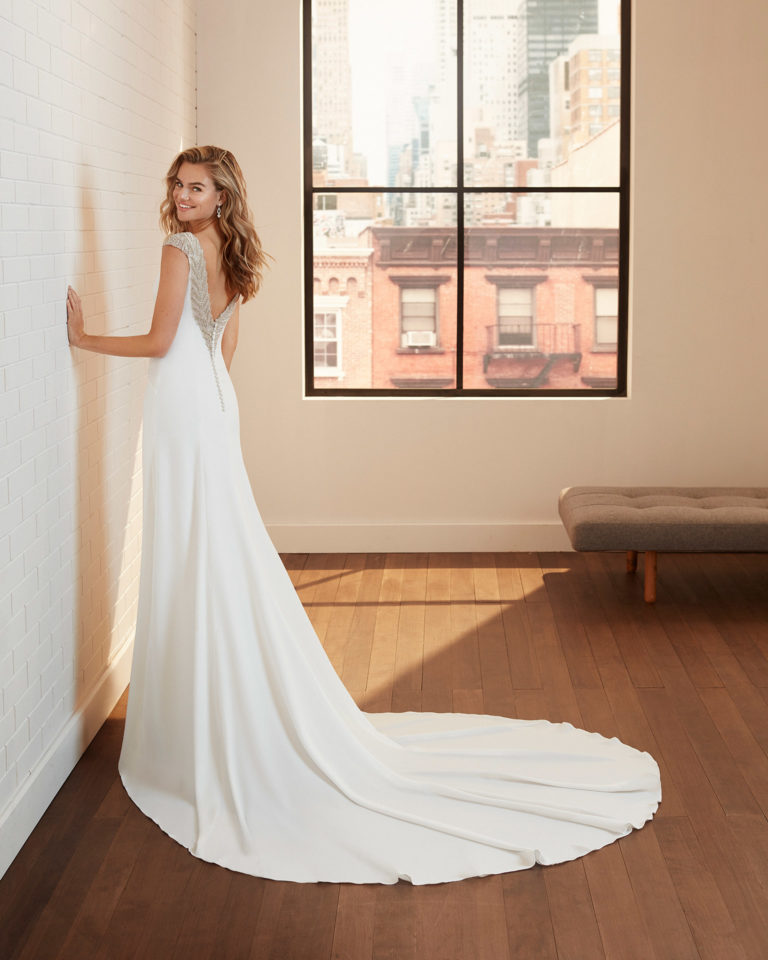 Sheath-style wedding dress in stretch crepe with low beaded back. 2020  Collection.
