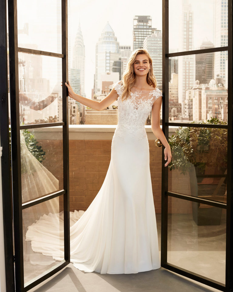 Ballgown-style wedding dress in crepe Georgette with corded lace and beading, with low back. 2020  Collection.