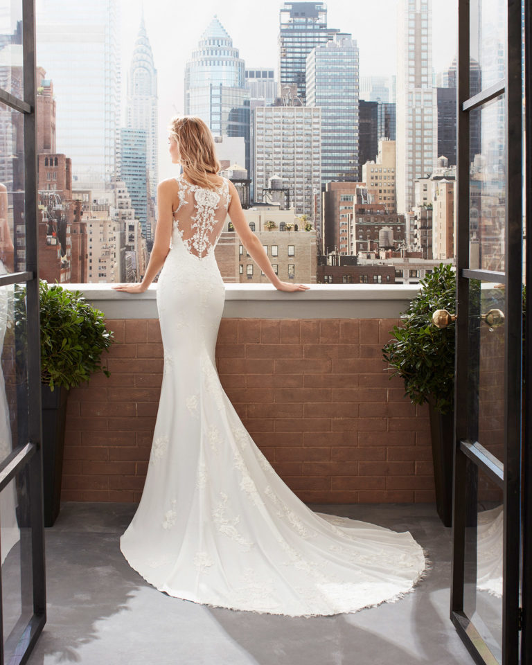 Mermaid-style wedding dress in stretch crepe and lace with tattoo-effect back. 2020  Collection.