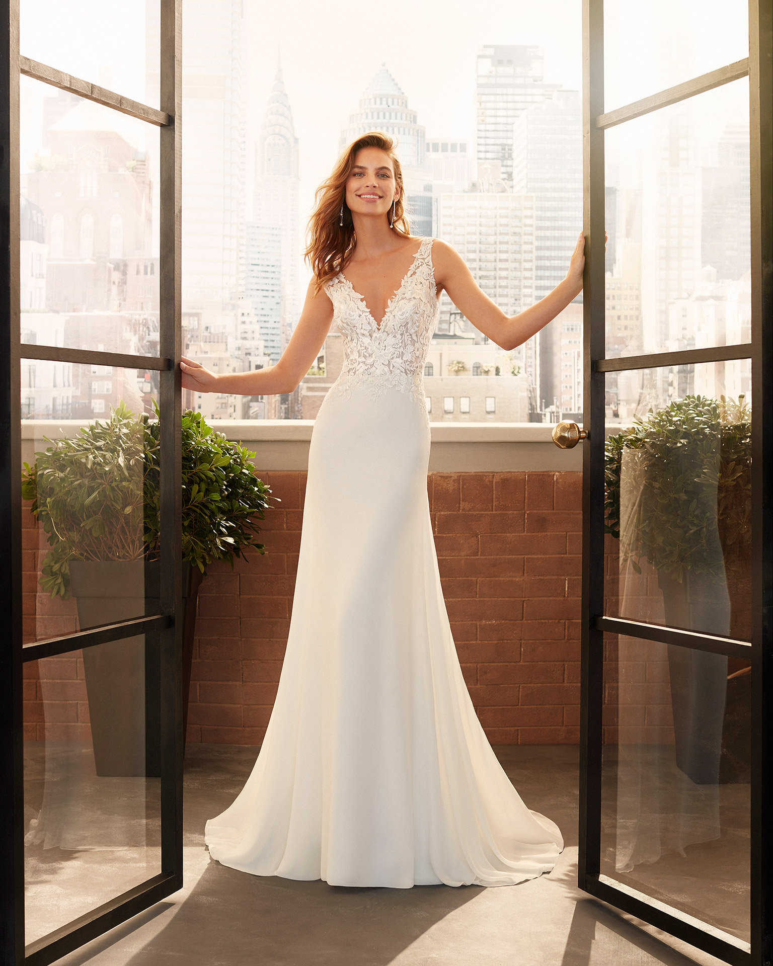 Ballgown-style lace and chiffon wedding dress with beaded neckline and armholes, V-neckline and tattoo-effect back. 2020  Collection.