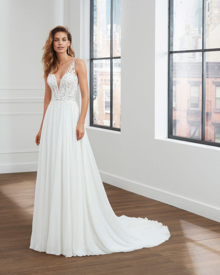 Peau d'ange voile wedding dress with pleats at the waist, deep-plunge neckline and back with sheer inserts. 2020  Collection.