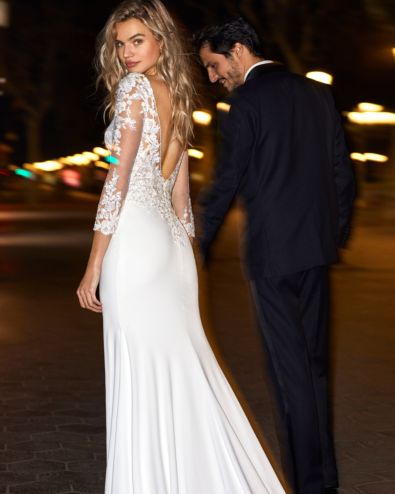 Mermaid-style wedding dress in stretch crepe with long sleeves and sheer insert with beaded neckline and low back. 2020  Collection.
