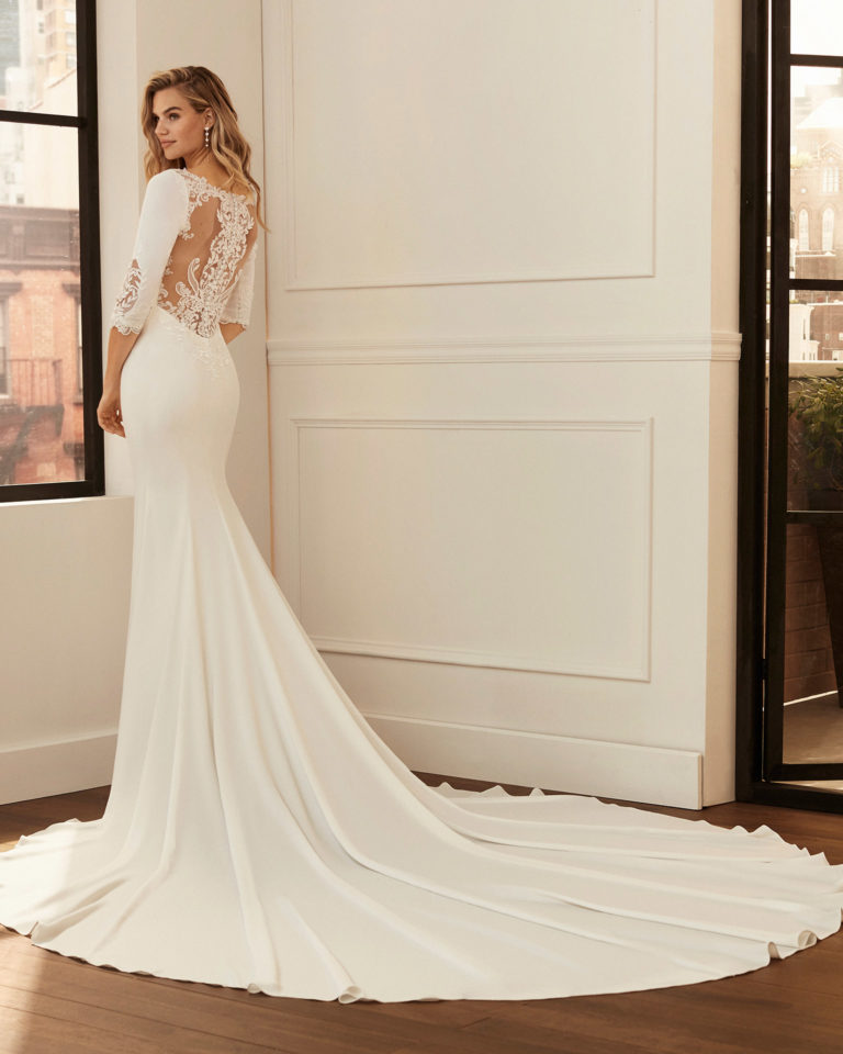 Mermaid-style wedding dress in stretch crepe with body-shaping lining, three-quarter sleeves, beading and lace back. 2020  Collection.