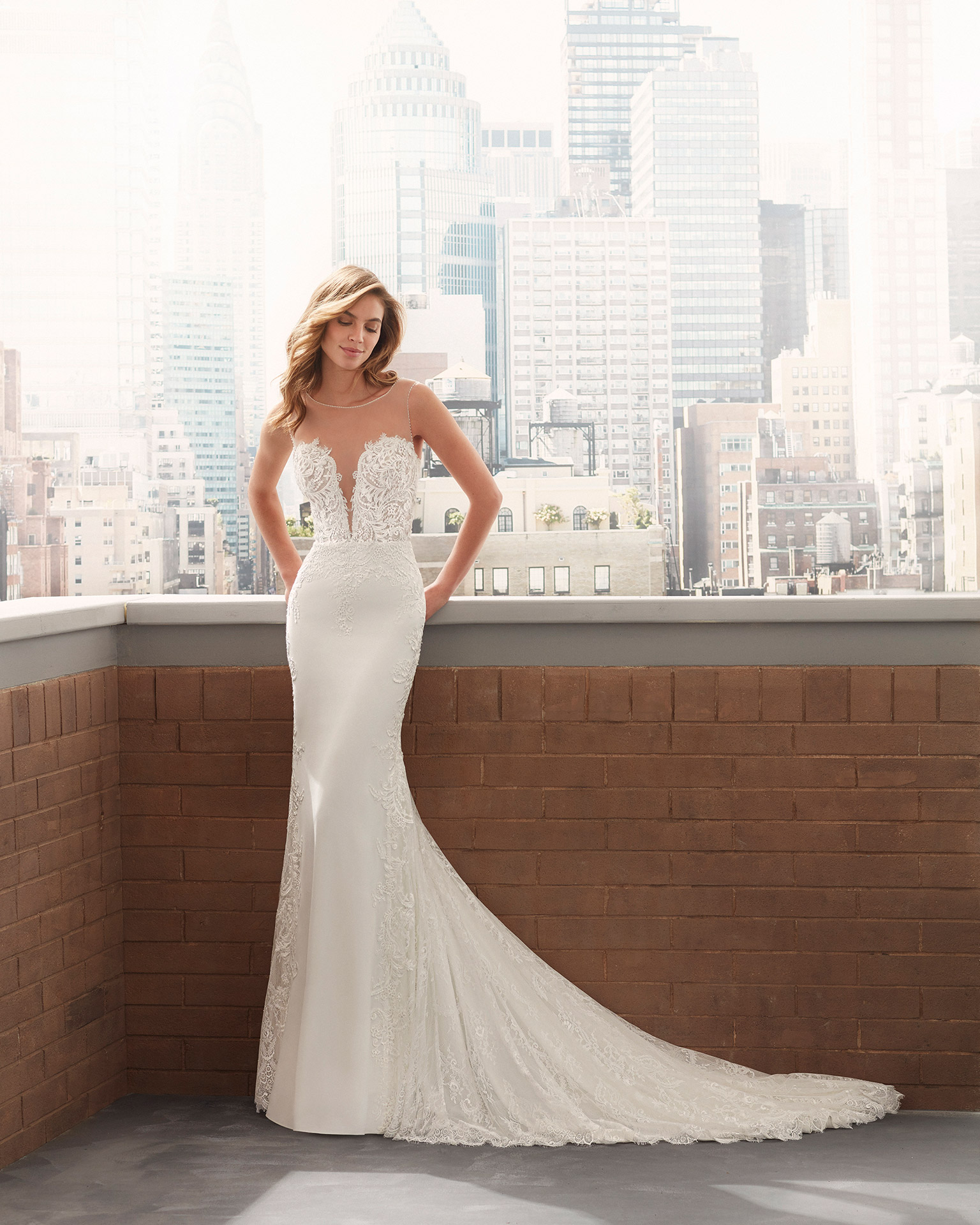 Mermaid-style wedding dress in stretch crepe with lace body-shaping lining, beading at the neckline and armholes, deep-plunge neckline and illusion back. 2020  Collection.