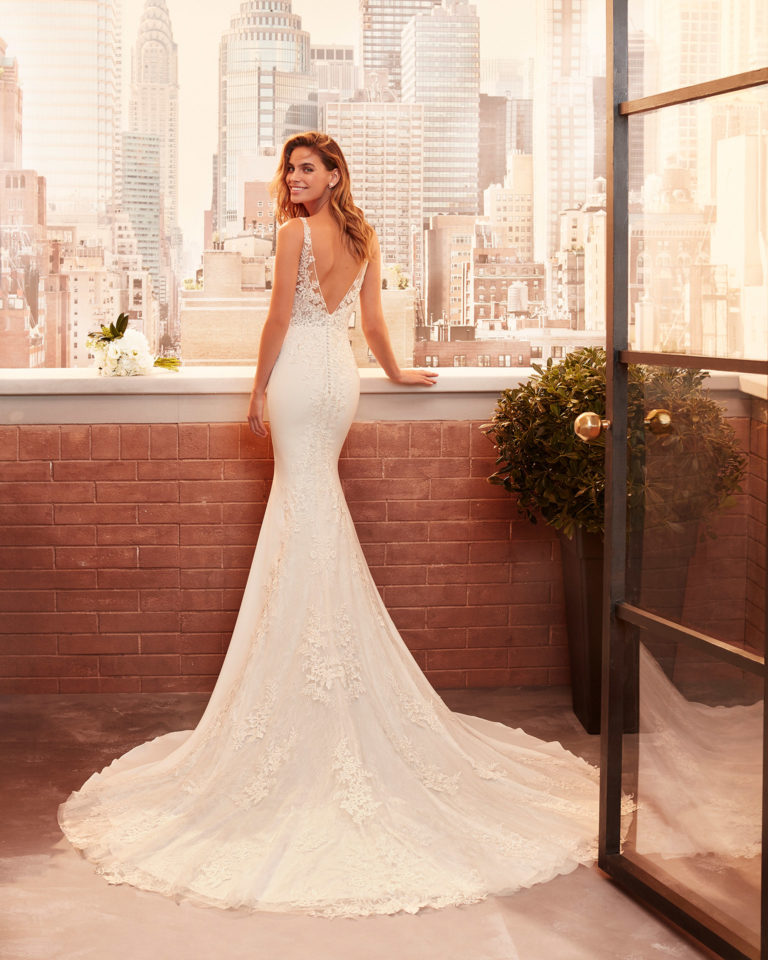 Mermaid-style wedding dress in stretch crepe and lace with beading and V-neckline and back. 2020  Collection.