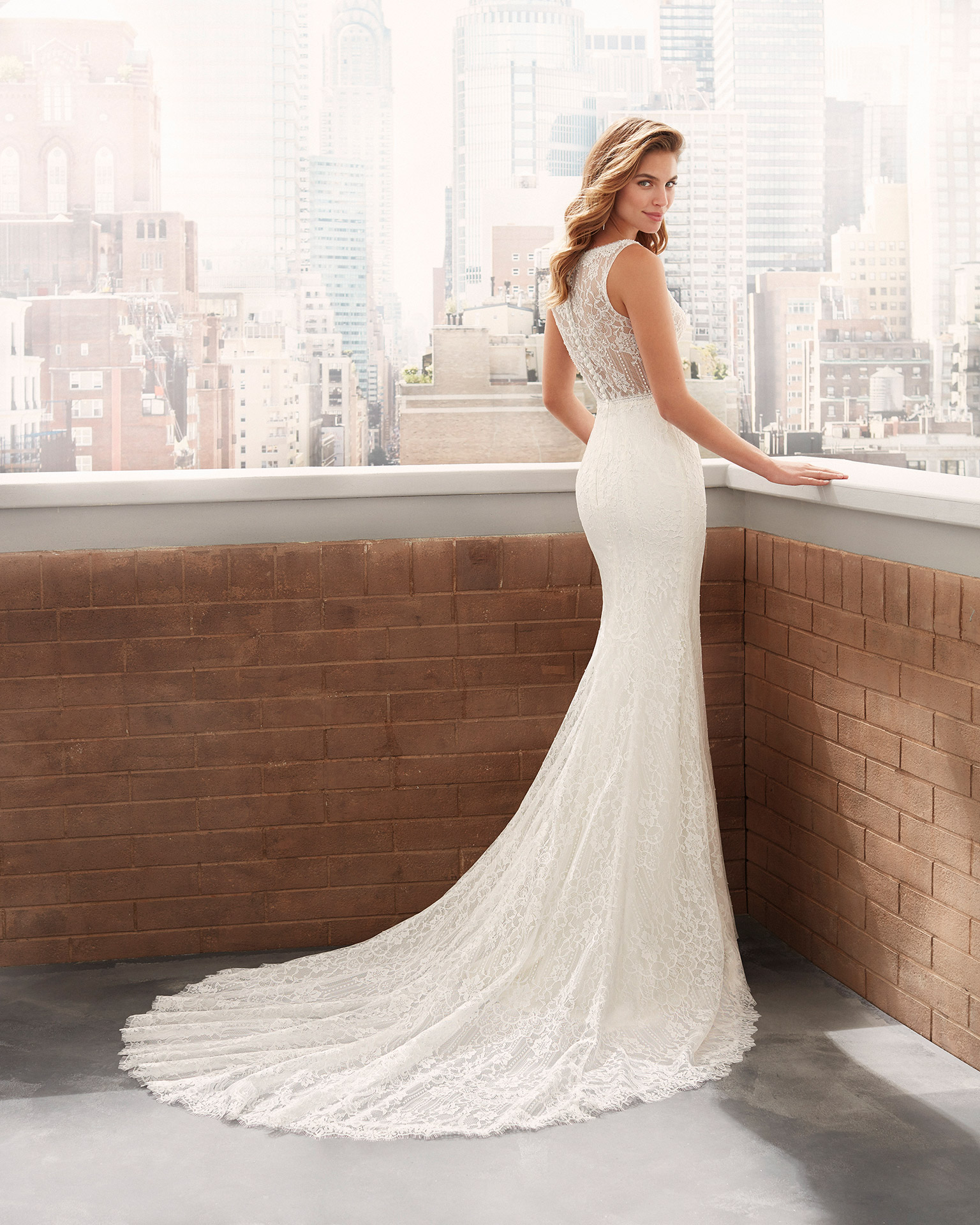 Mermaid-style wedding dress in beaded lace with deep-plunge neckline and lace back. 2020  Collection.