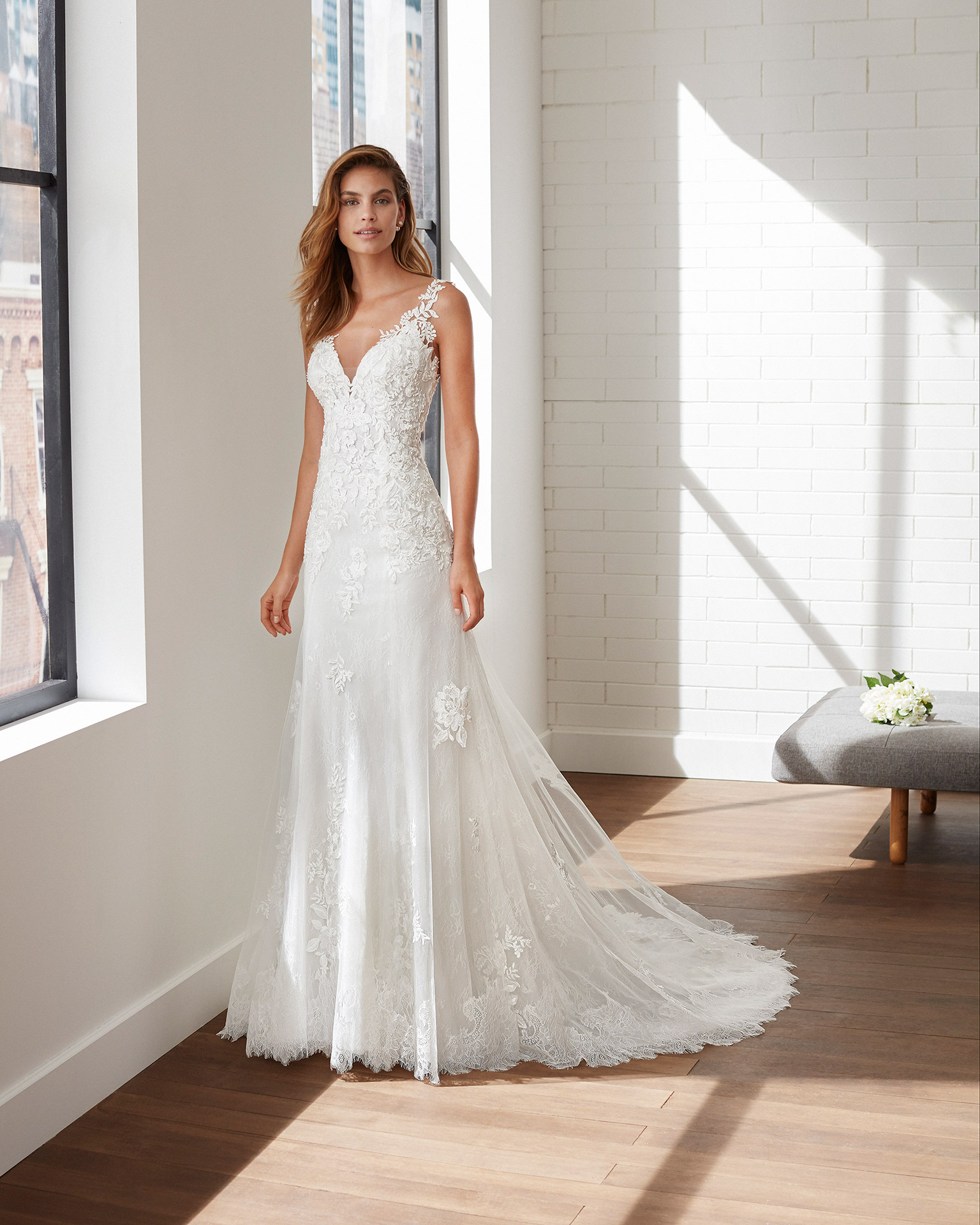Sheath-style lace and tulle wedding dress with beading, deep-plunge neckline and illusion back. 2020  Collection.