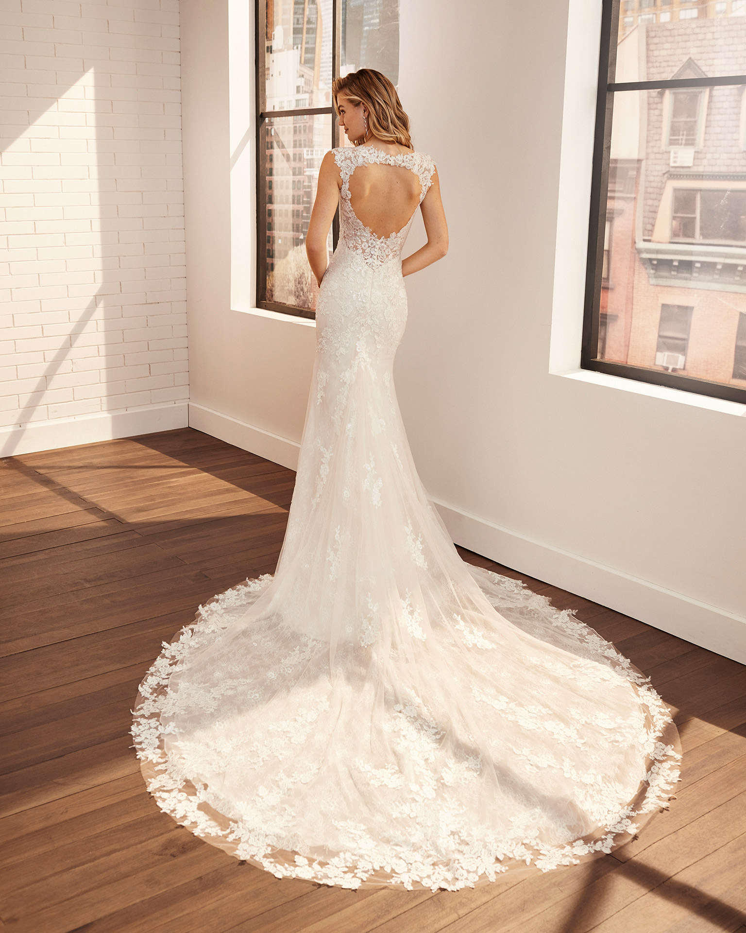 Mermaid-style wedding dress in lace and tulle with beading and illusion back. 2020  Collection.