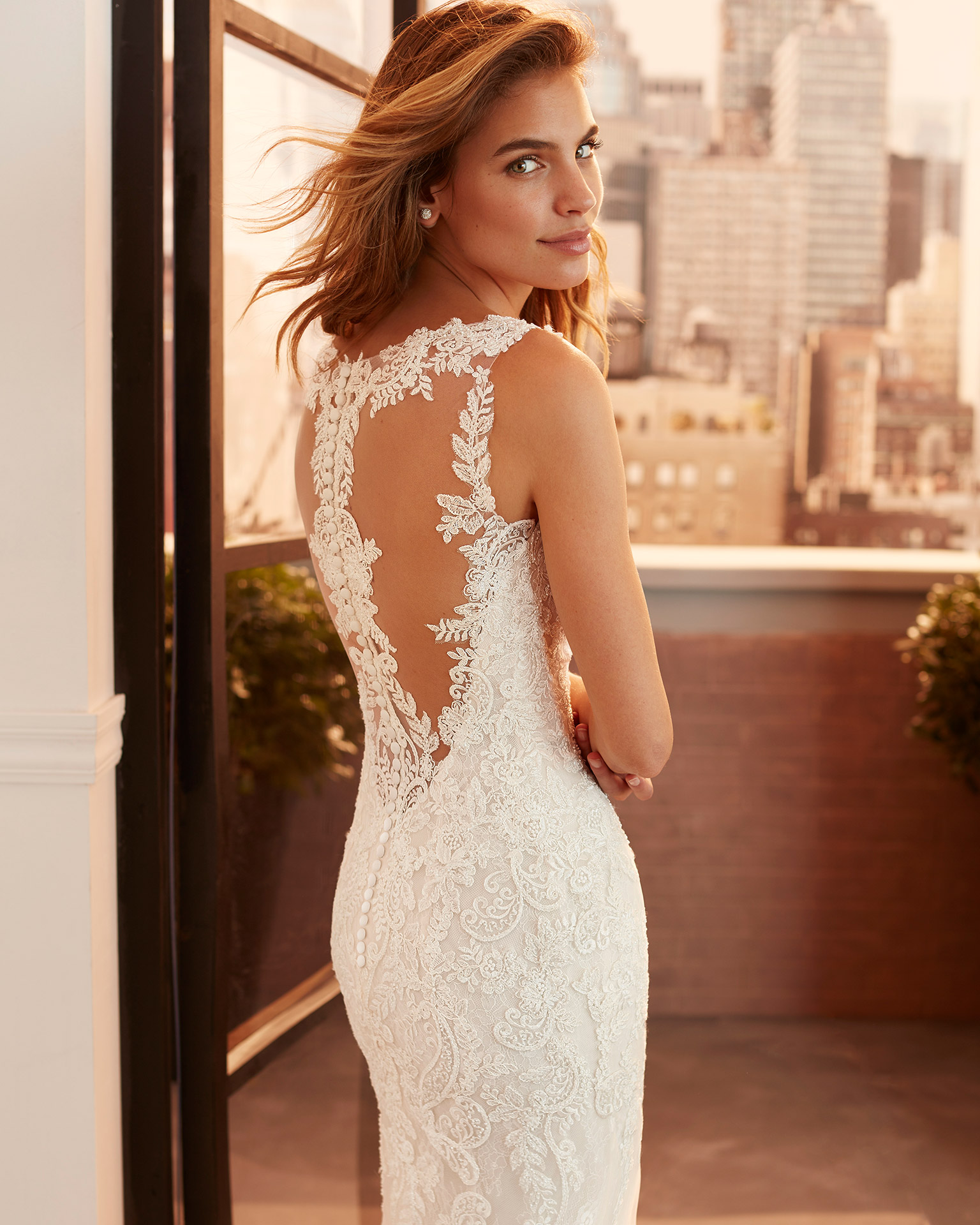 Mermaid-style wedding dress in corded lace and tulle with beading, V-neckline and illusion back. 2020  Collection.