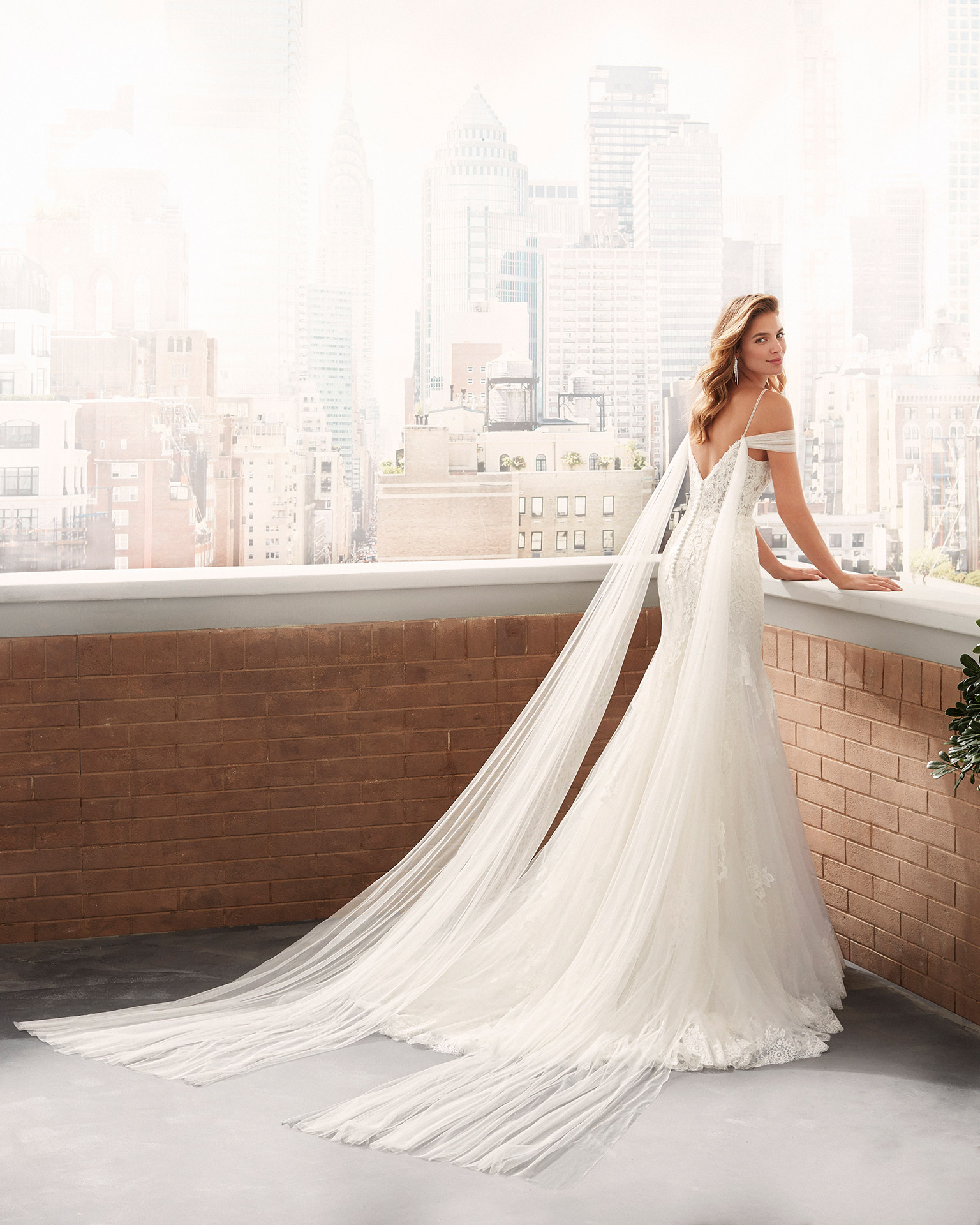Mermaid-style wedding dress in corded lace and tulle with beaded straps, tulle draping and V-back. 2020  Collection.