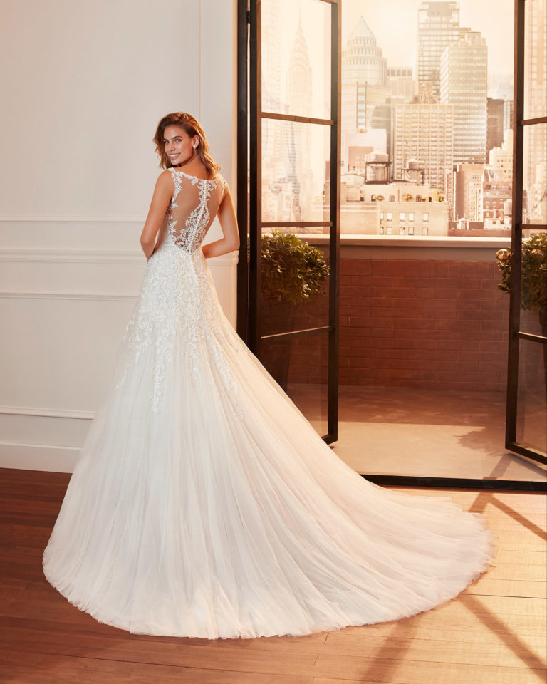 Romantic lace and tulle wedding dress with V-neckline and back with sheer inserts. 2020  Collection.