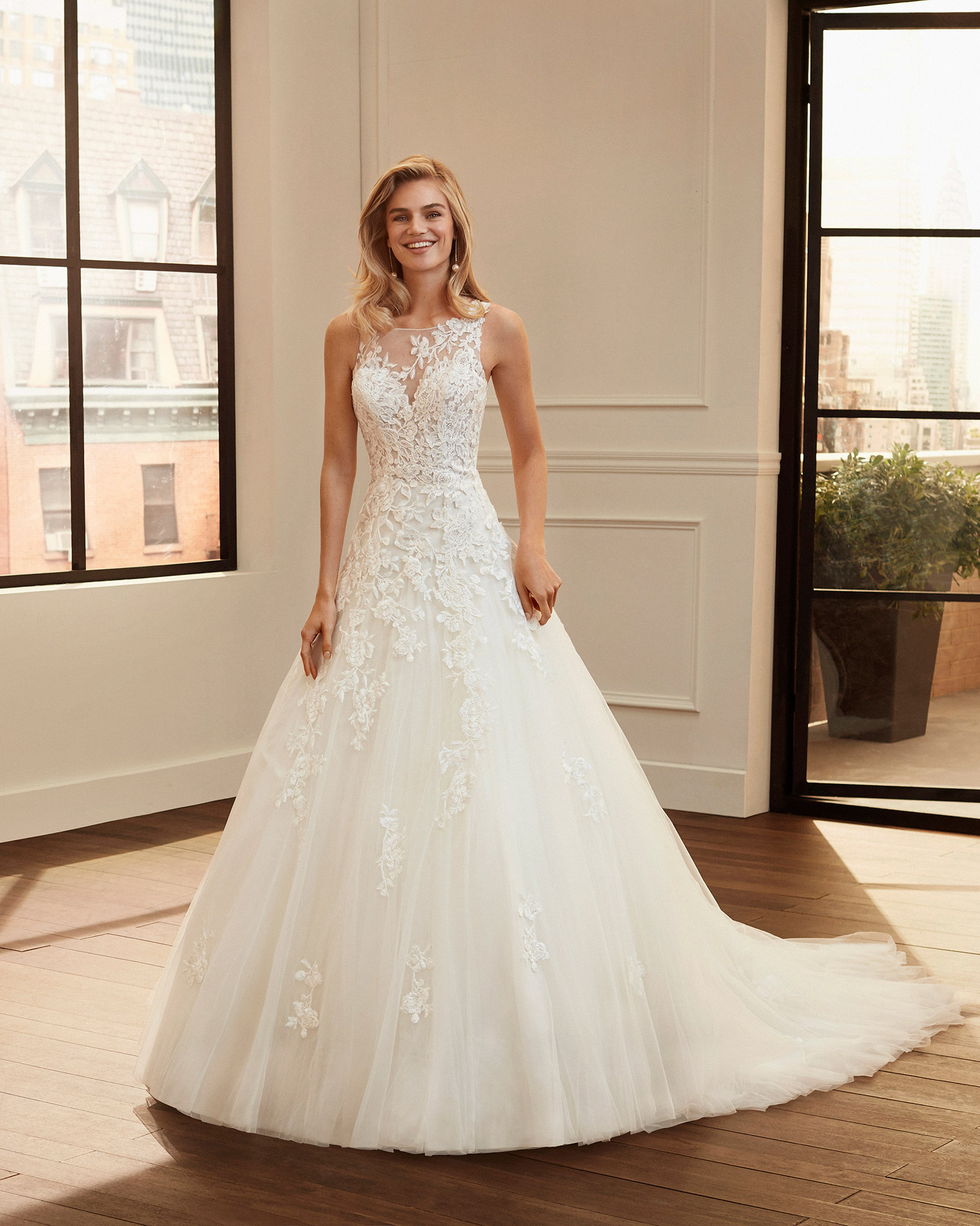 Romantic corded lace and tulle wedding dress with neckline and back with sheer inserts. 2020  Collection.