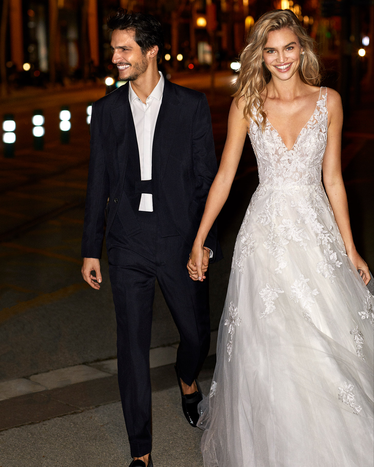 Romantic lace and tulle wedding dress with beading at the neckline and armholes, V-neckline and back and full skirt. 2020  Collection.