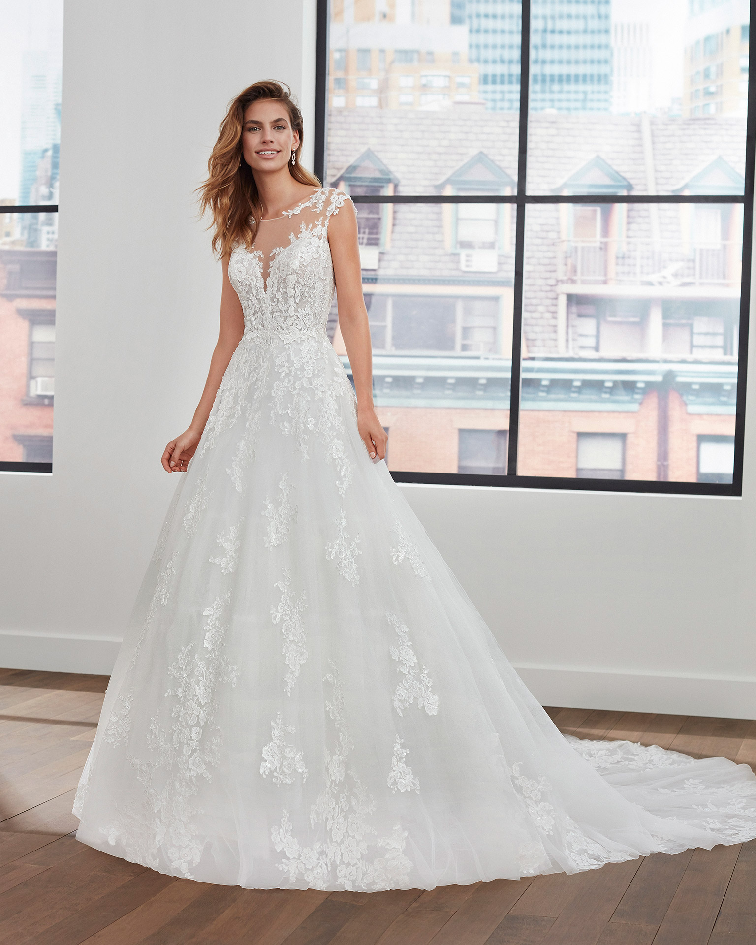 Princess-style lace and tulle wedding dress with beading and neckline and back with sheer inserts. 2020  Collection.