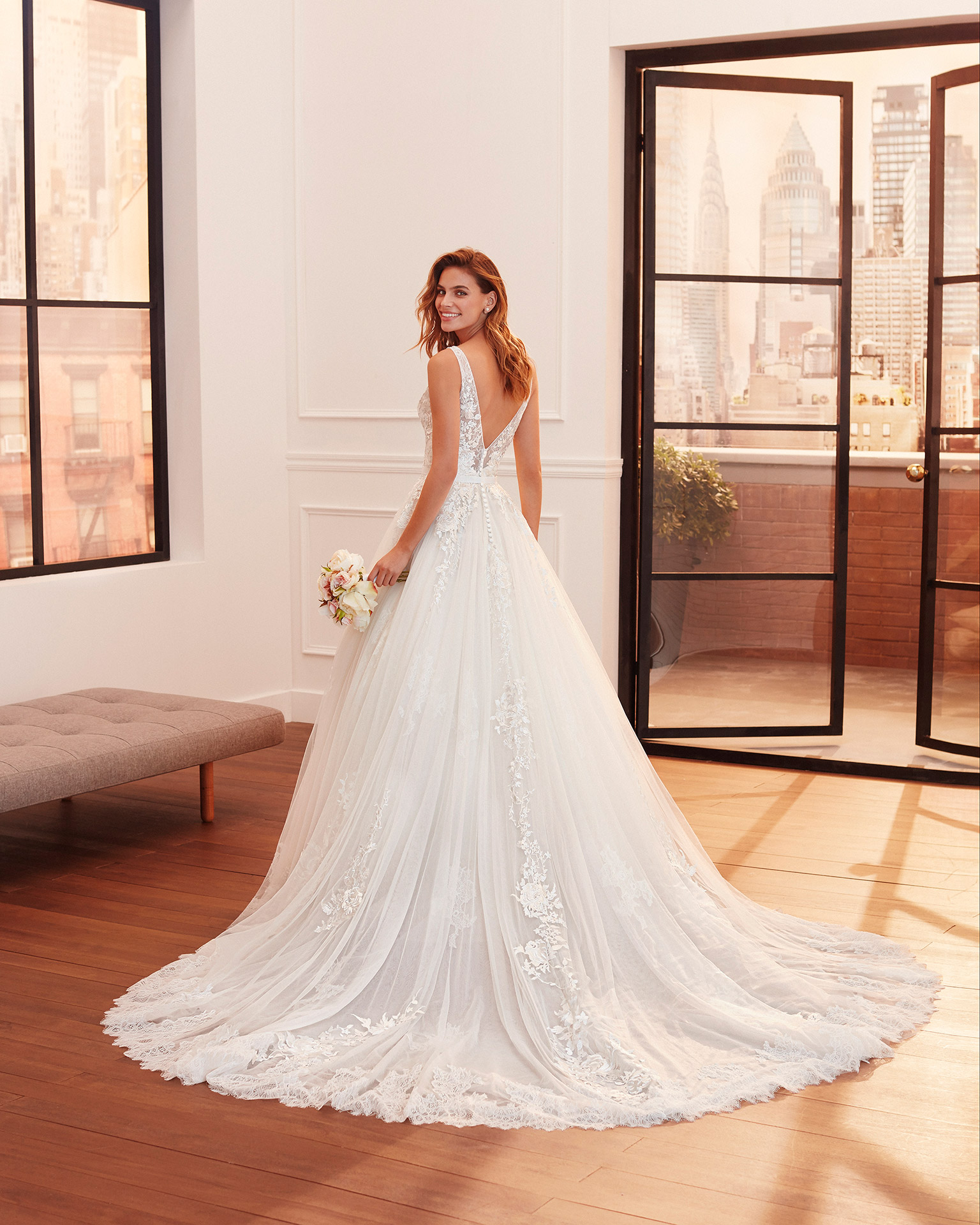 Princess-style lace and tulle wedding dress with beaded neckline and V-back. 2020  Collection.