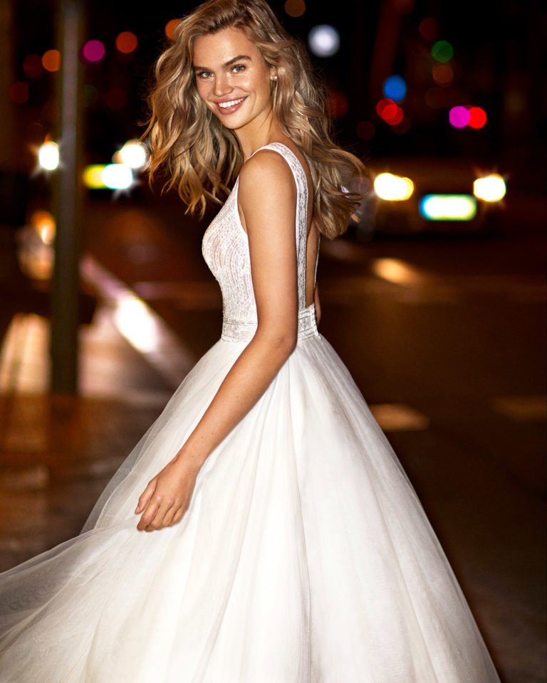 Romantic tulle and lace wedding dress with beading, V-neckline and square back. 2020  Collection.