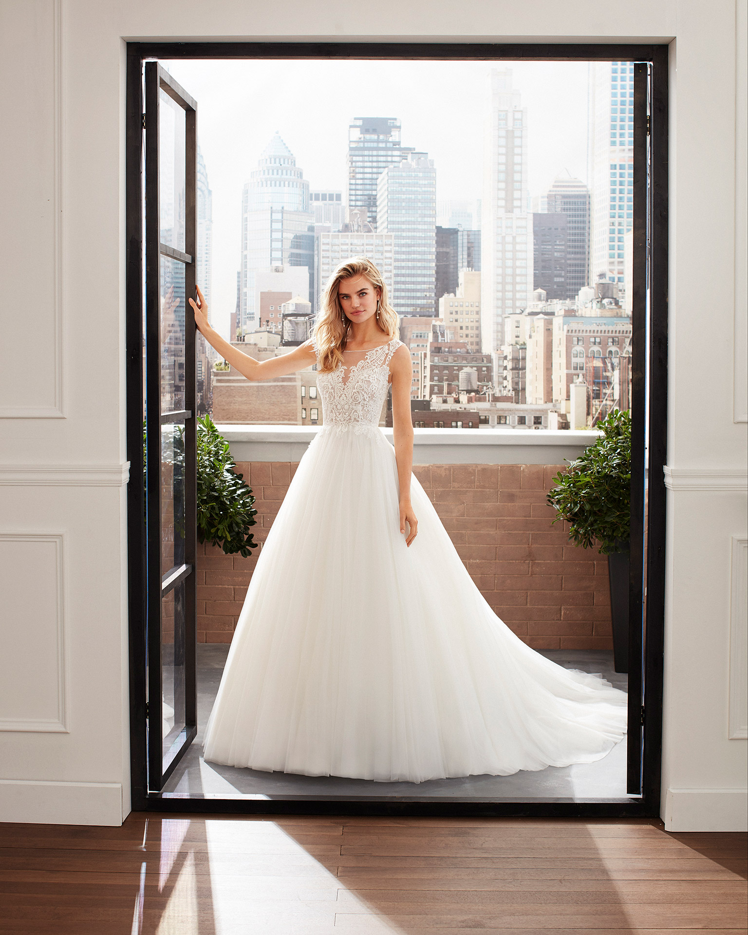 Princess-style tulle and lace wedding dress with beading and neckline and back with sheer inserts. 2020  Collection.