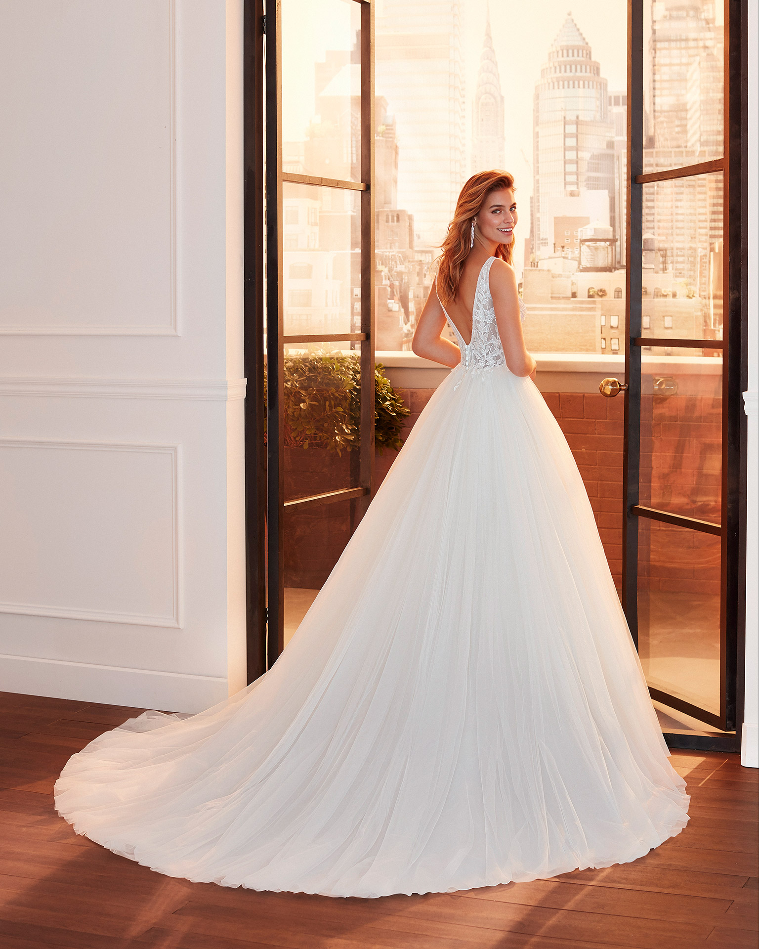 Princess-style soft tulle and lace wedding dress with beading at the neckline and armholes, V-neckline and back and full skirt. 2020  Collection.