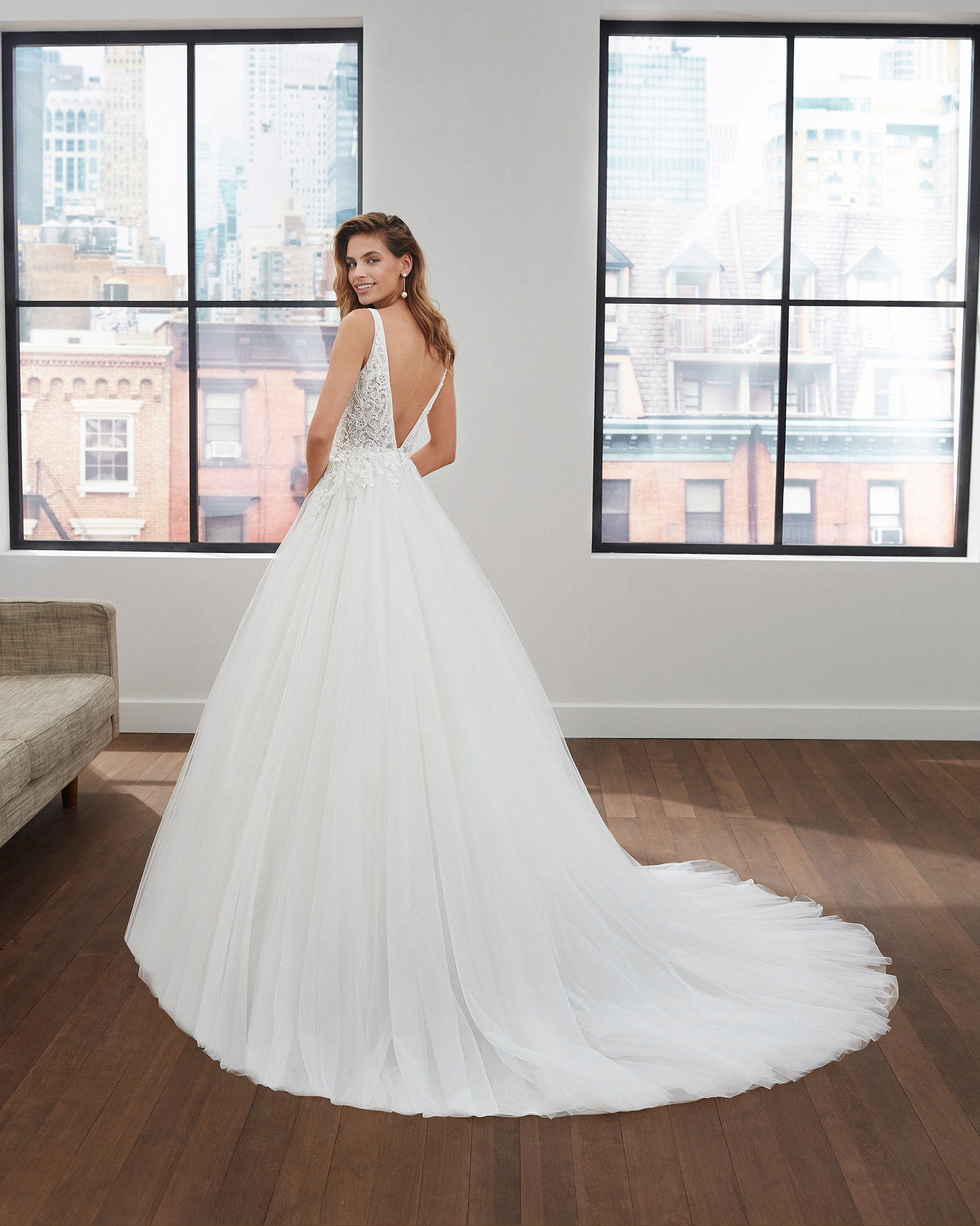 Princess-style lace and tulle wedding dress with beading, deep-plunge neckline and V-back. 2020  Collection.