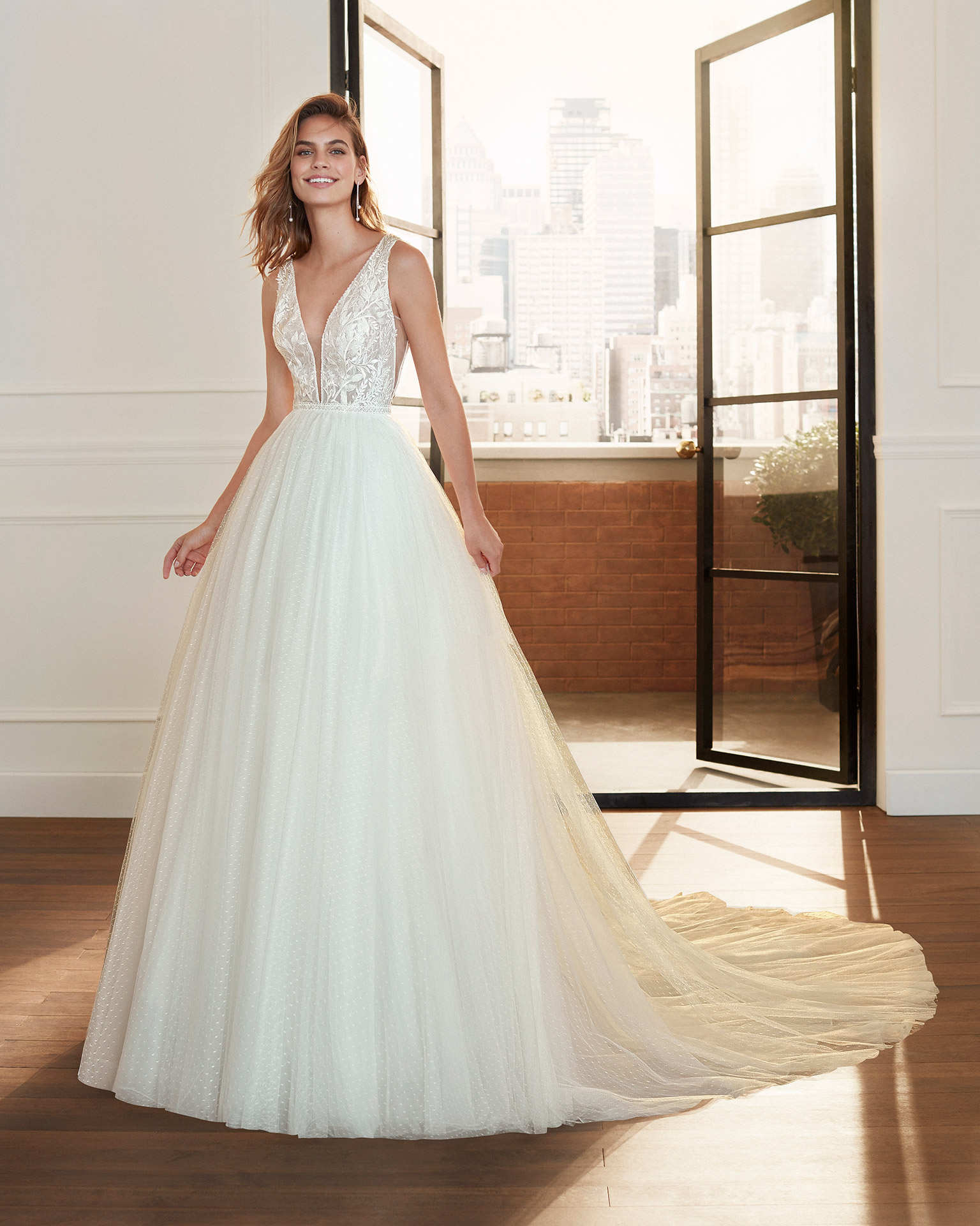 Romantic lace and dot tulle wedding dress with beading, deep-plunge neckline and V-back. 2020  Collection.