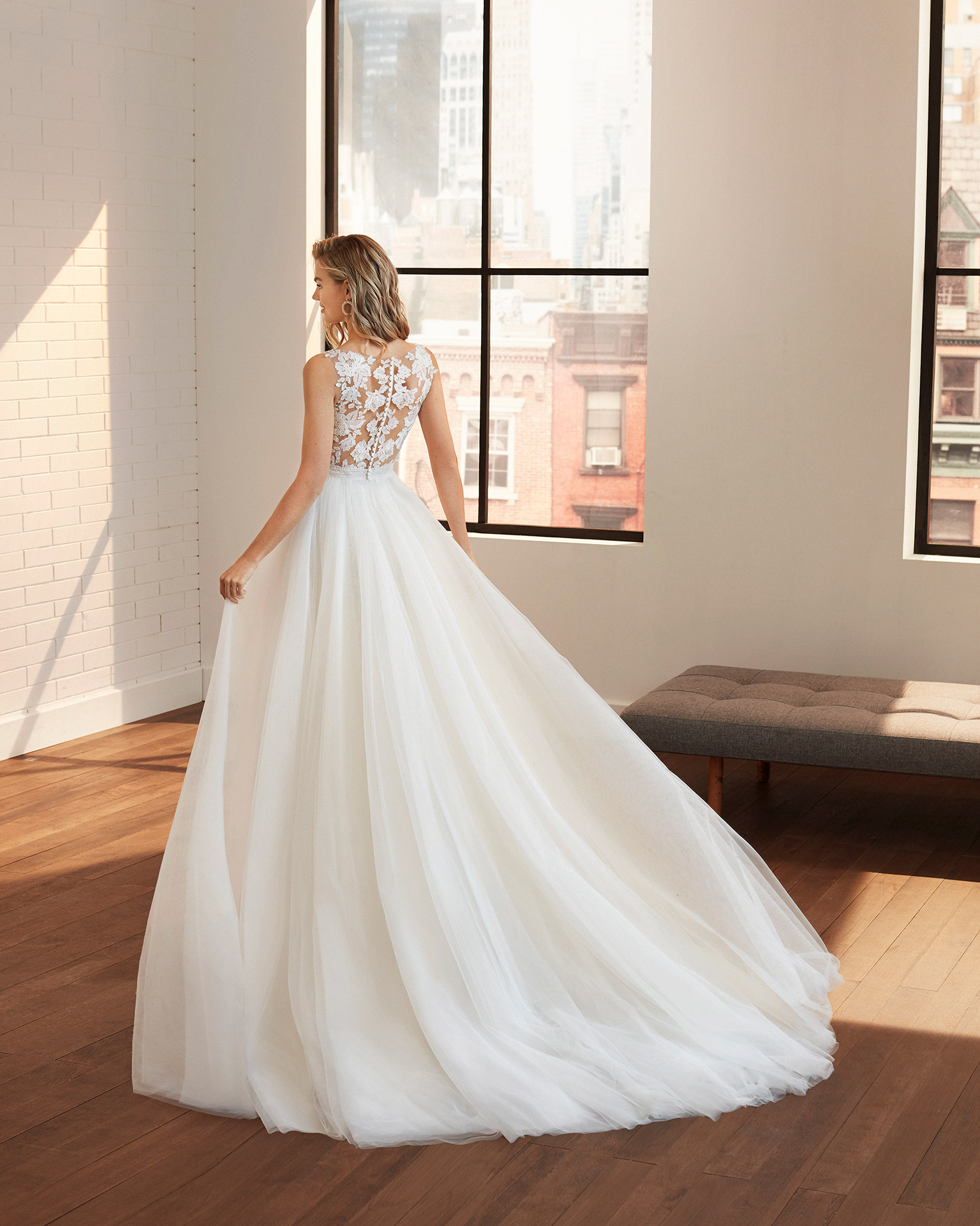 Princess-style tulle and lace wedding dress with beading at the waist and neckline and back with sheer inserts. 2020  Collection.