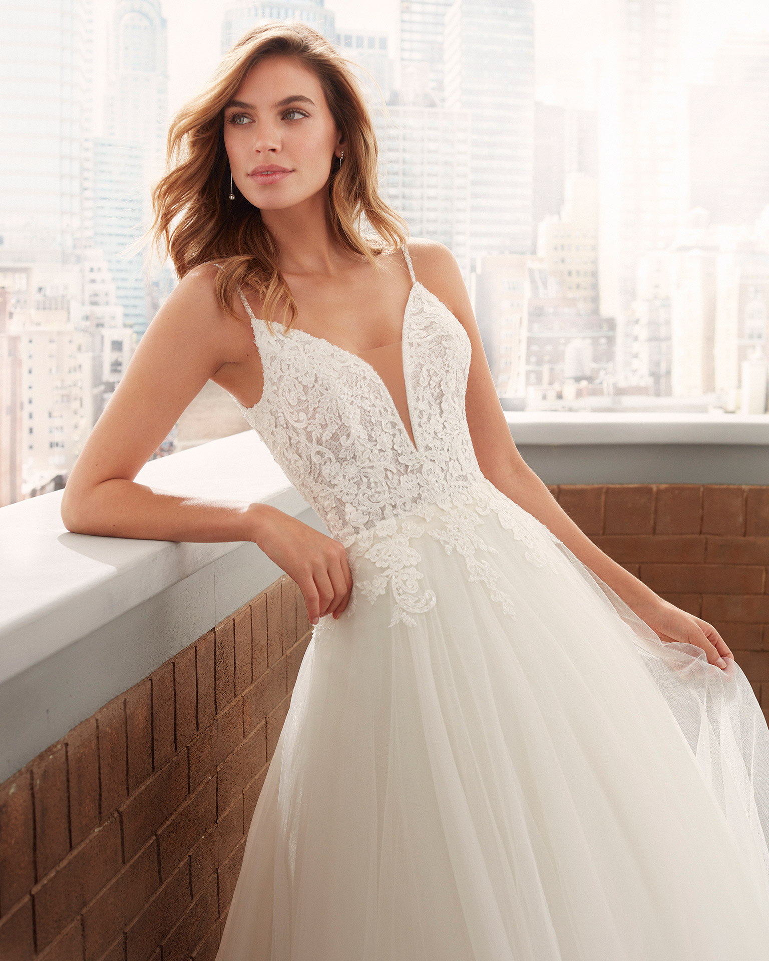 Romantic lace and soft tulle wedding dress with beading, deep-plunge neckline and low back. 2020  Collection.