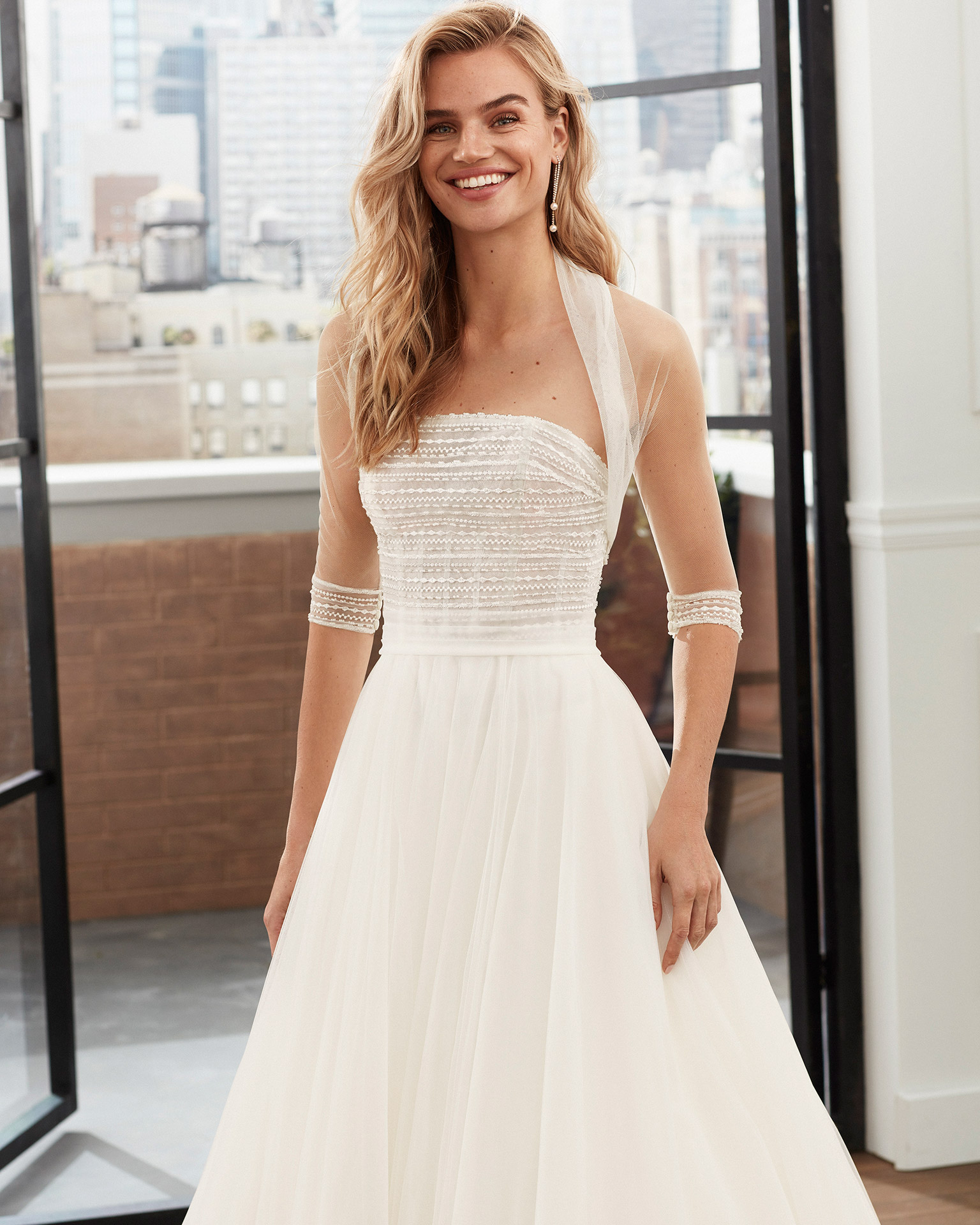 Romantic beaded soft tulle wedding dress with strapless neckline and full skirt. 2020  Collection.