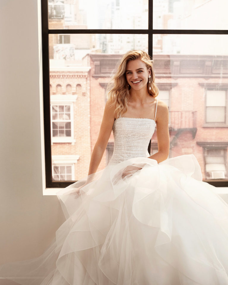 Strapless ballgown-style embroidered and beaded tulle wedding dress with flounced skirt. 2020  Collection.