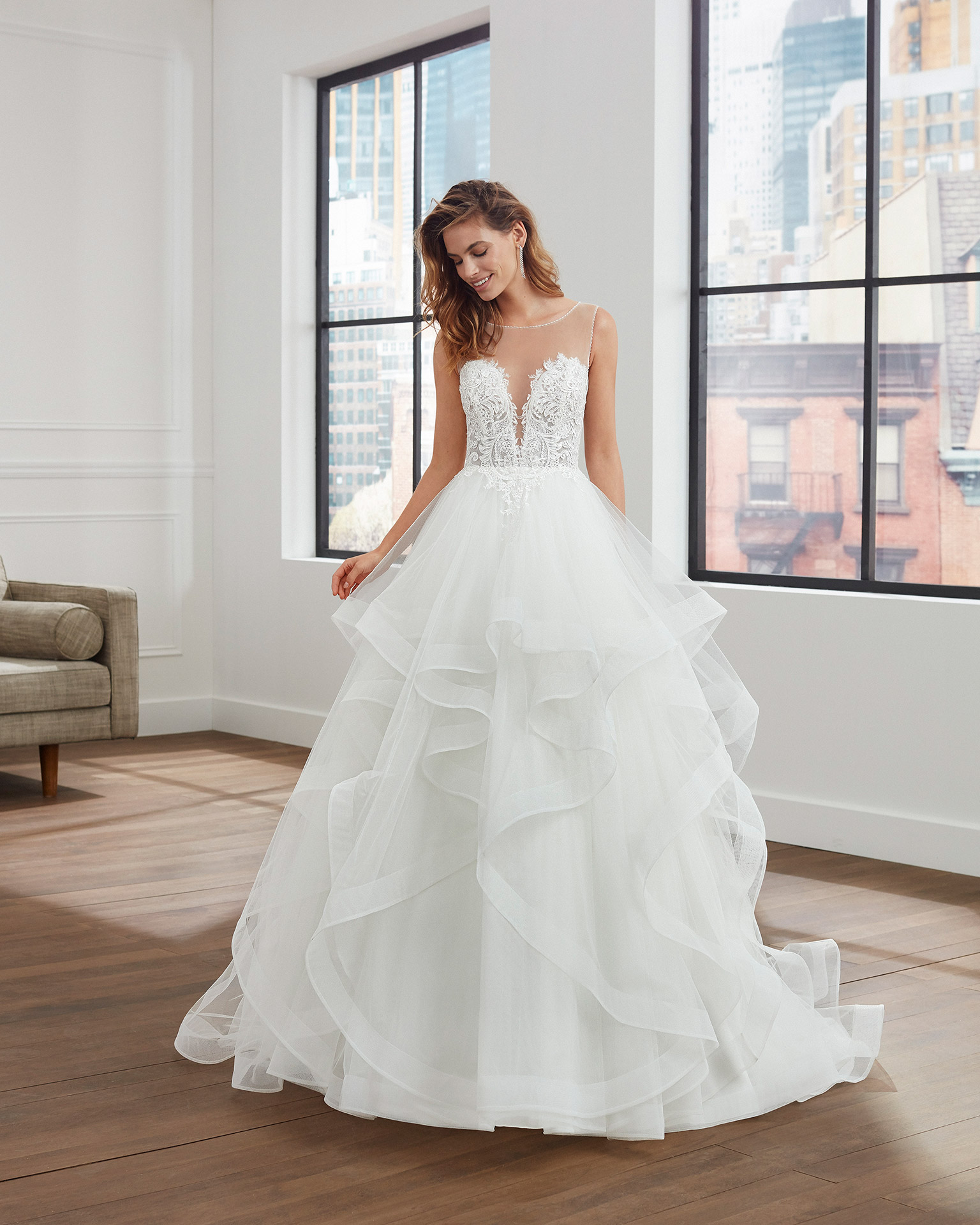 Ballgown-style tulle and lace wedding dress with beading, deep-plunge neckline and flounced skirt. 2020  Collection.