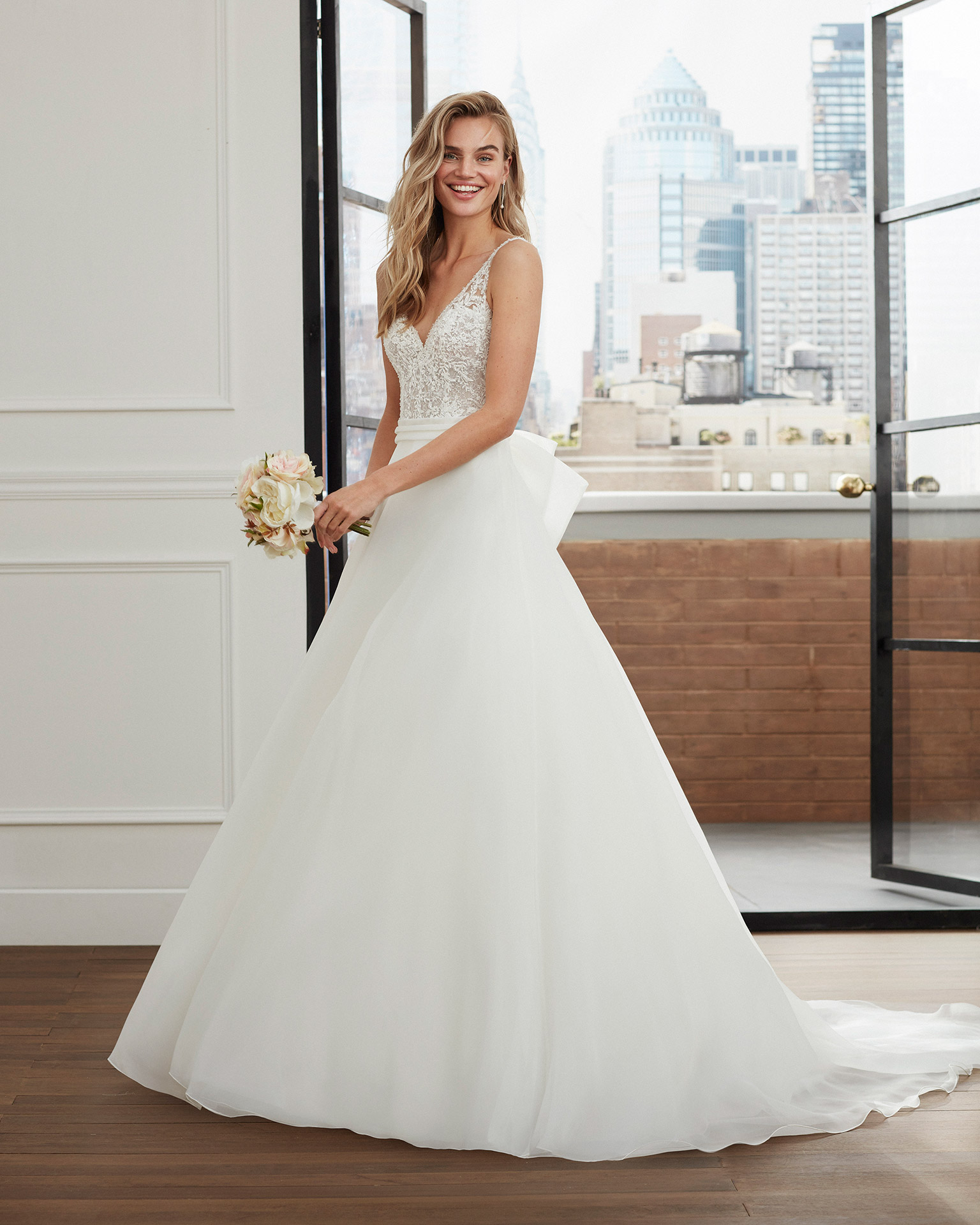 Romantic lace and garza wedding dress with beading and V-neckline and back. 2020  Collection.