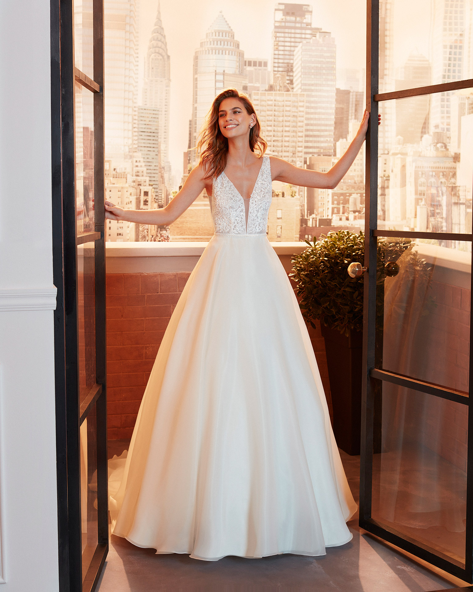 Classic beaded lace wedding dress with deep-plunge neckline and low V-back. 2020  Collection.