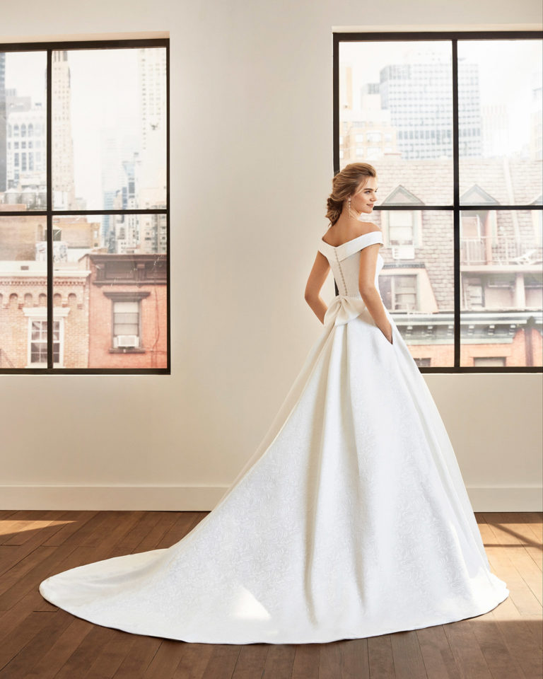 Classic brocade wedding dress and lace belt with off-the-shoulder neckline. 2020  Collection.