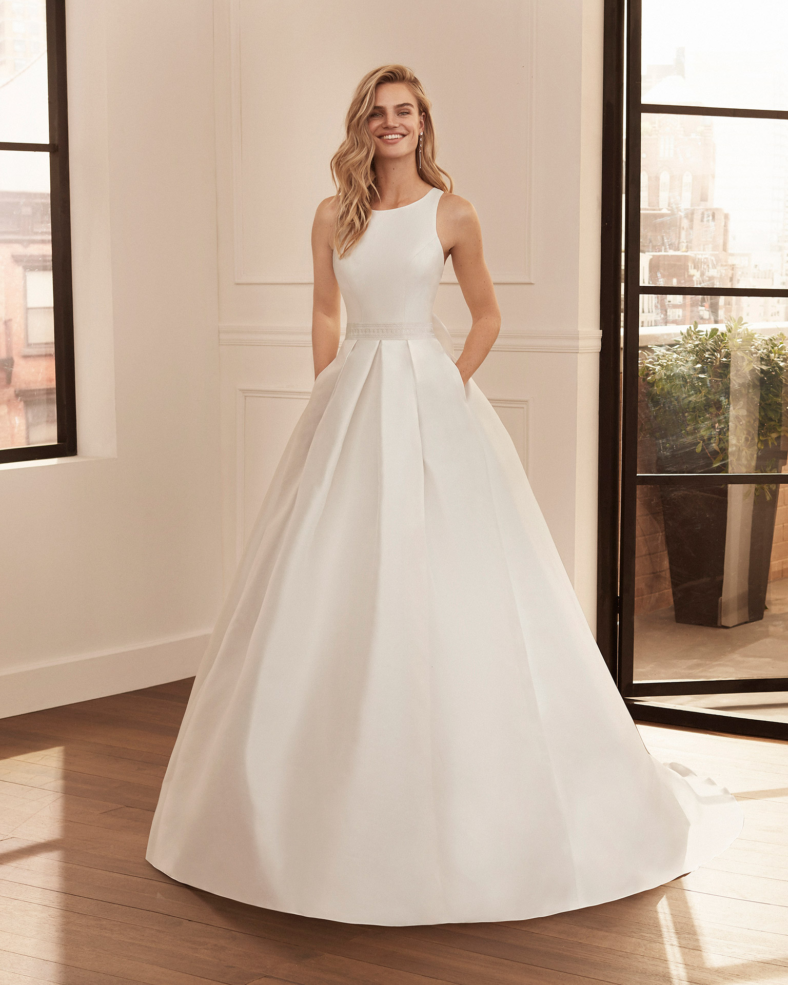 Classic wedding dress in bari with lace belt, bateau neckline and crossover back. 2020  Collection.