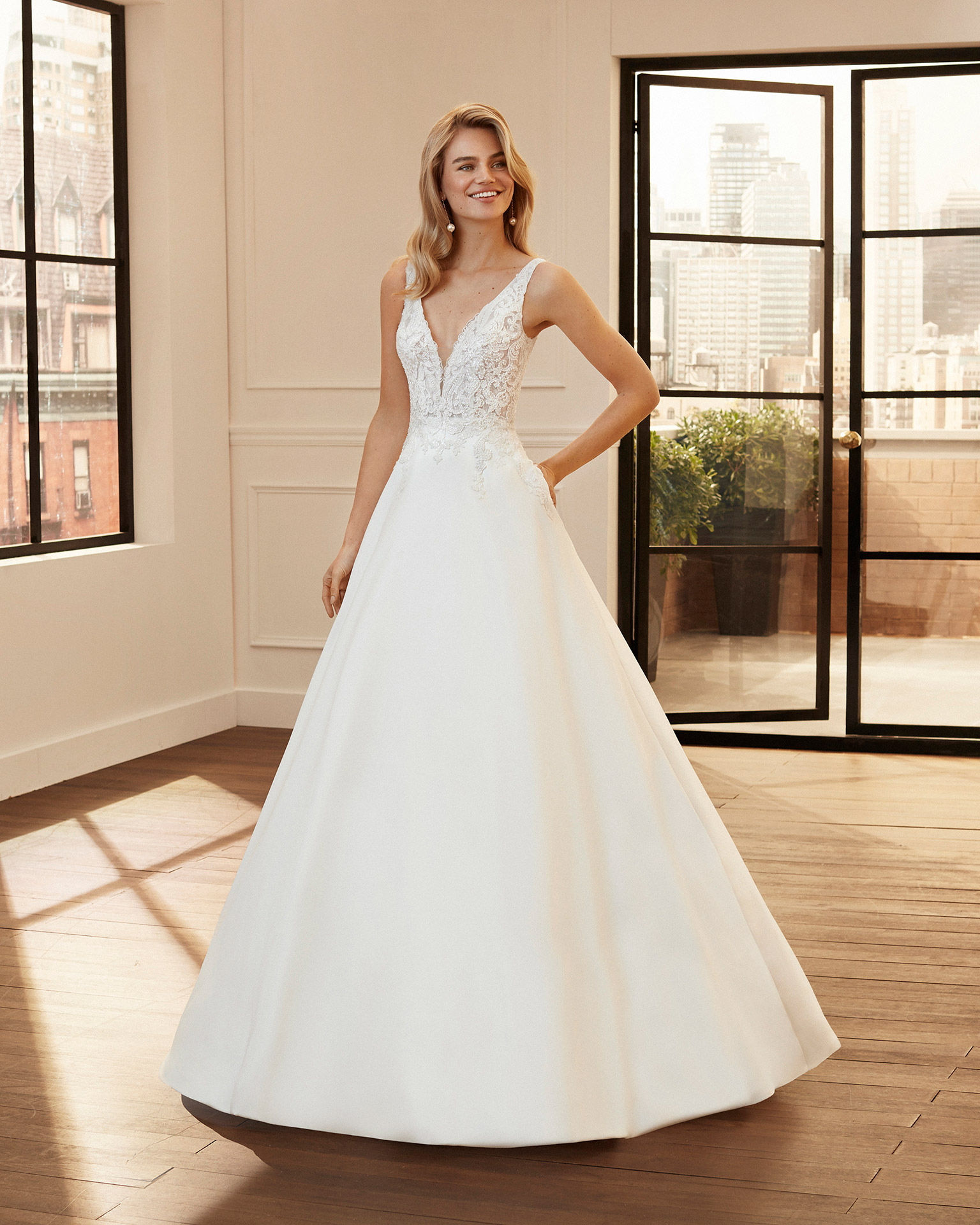 A-line lace and mikado wedding dress with beading and deep-plunge neckline and V-back. 2020  Collection.