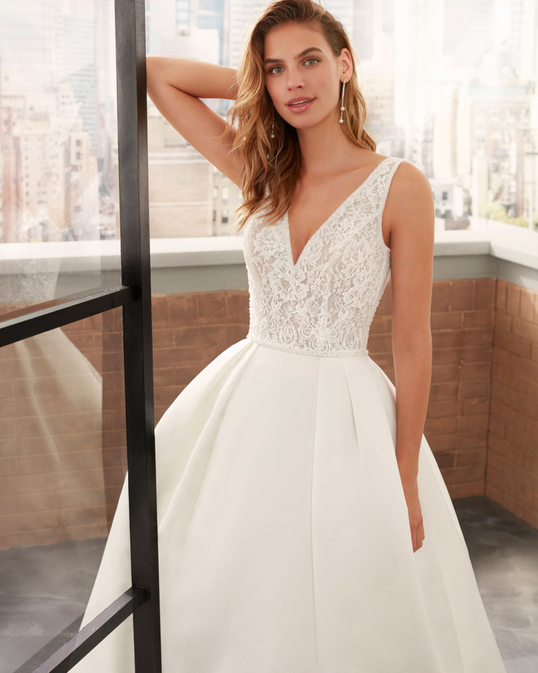 Classic lace and satin wedding dress with beading and V-neckline and back. 2020  Collection.