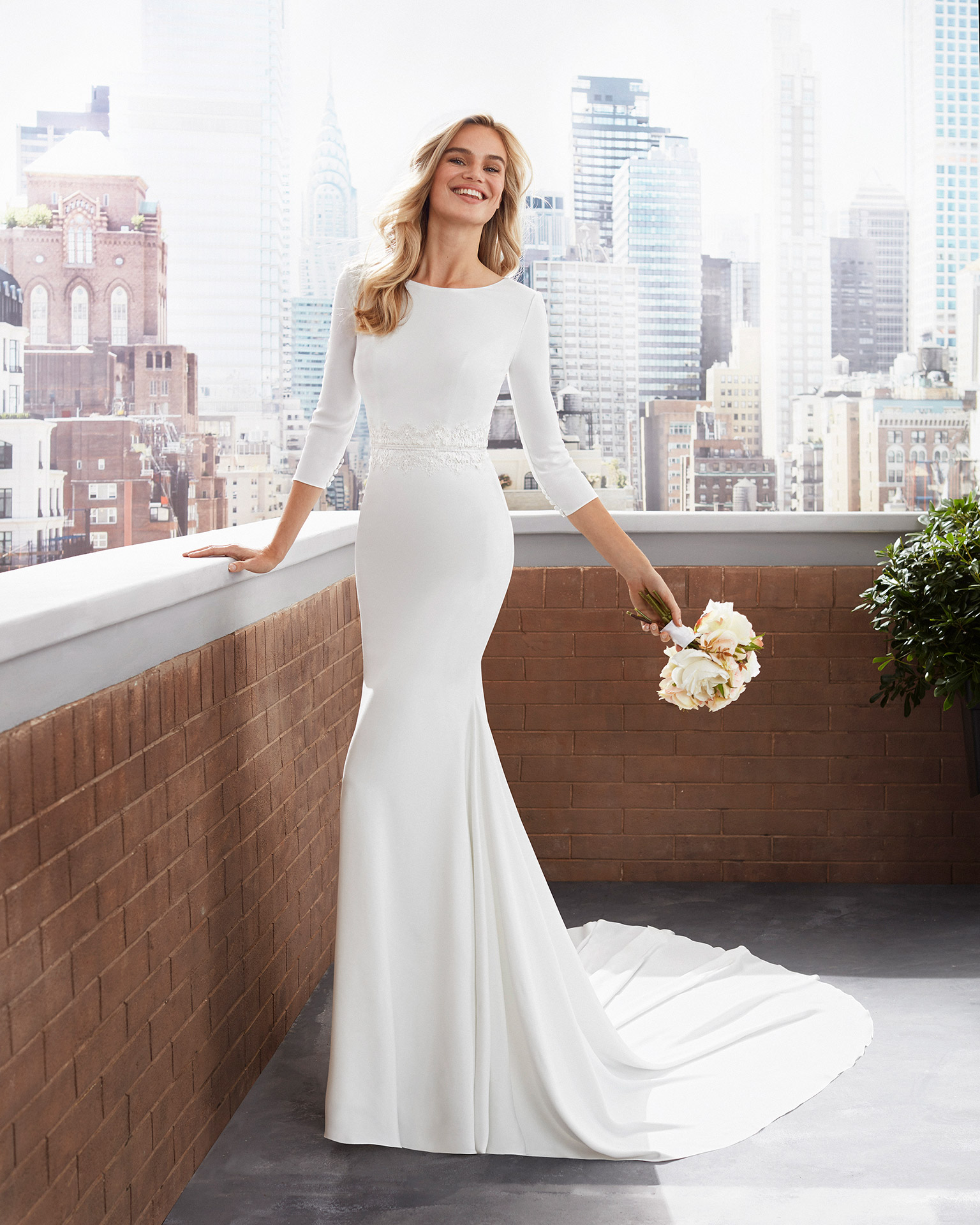 Mermaid-style lace and crepe wedding dress with round neckline, V-back and three-quarter sleeves. 2020  Collection.