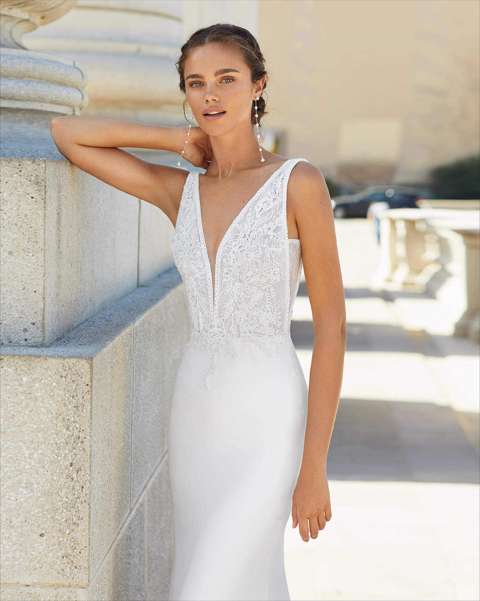 Sheath-style wedding dress in stretch crepe and beaded lace. Deep-plunge neckline and low back. 2021  Collection.