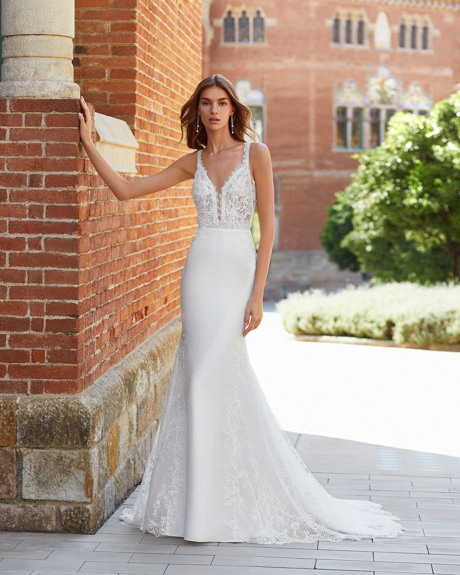 Mermaid-style wedding dress in stretch crepe and beaded lace. Deep-plunge neckline and V-back. 2021  Collection.