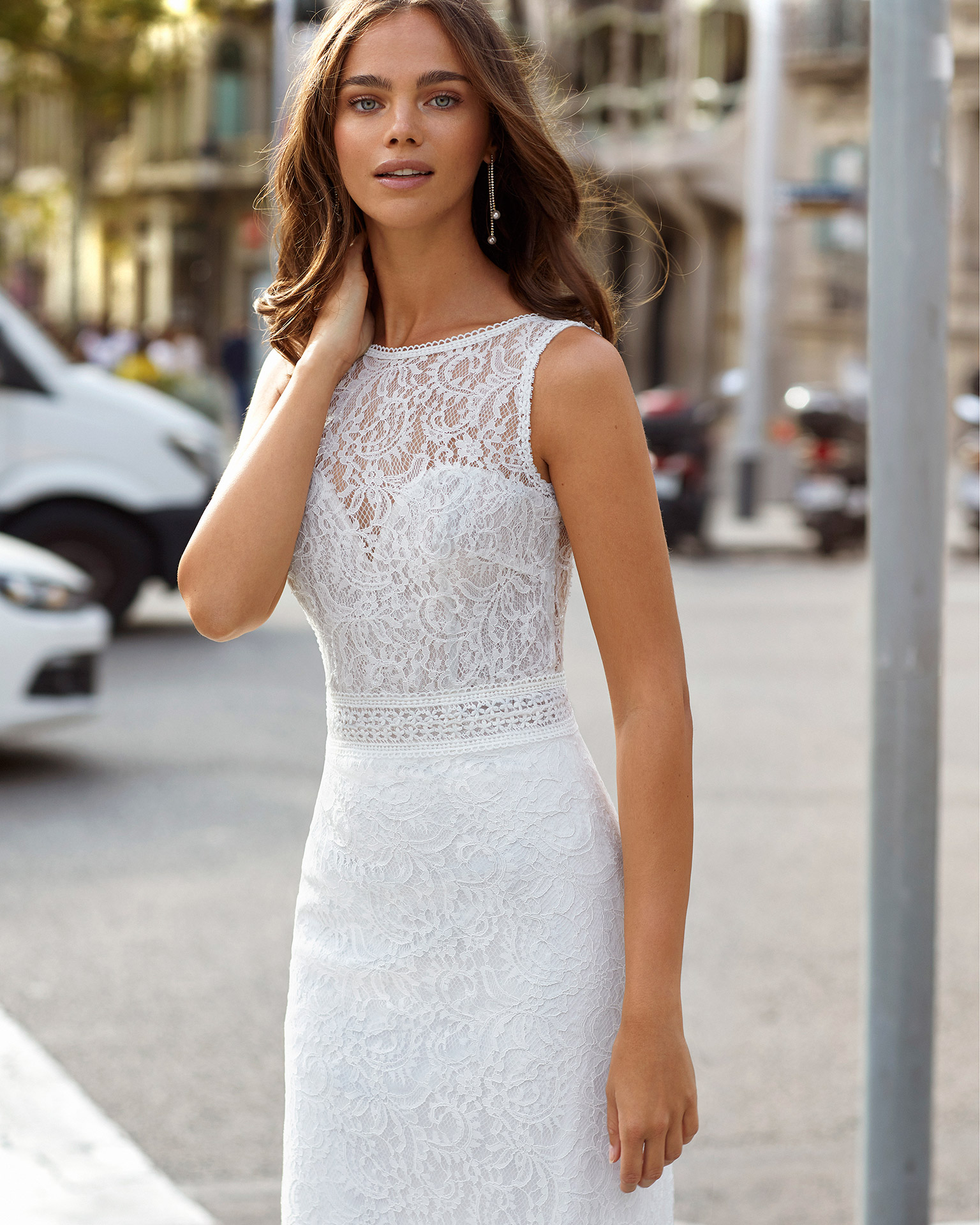 Sheath-style wedding dress in beaded lace. Bateau neckline with sweetheart underlay and V-back. 2021  Collection.