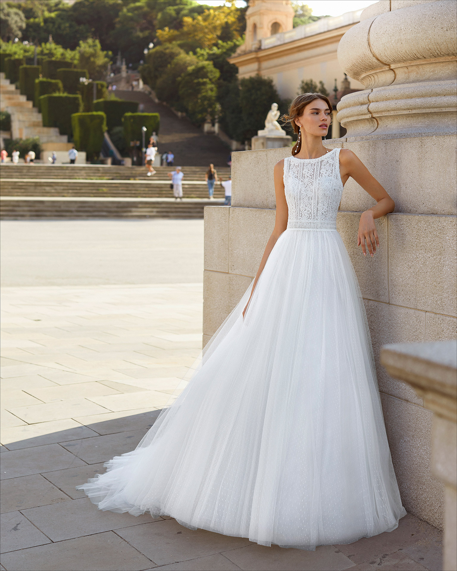 Ballgown-style wedding dress in dot tulle and beaded lace. Bateau neckline and V-back. 2021  Collection.