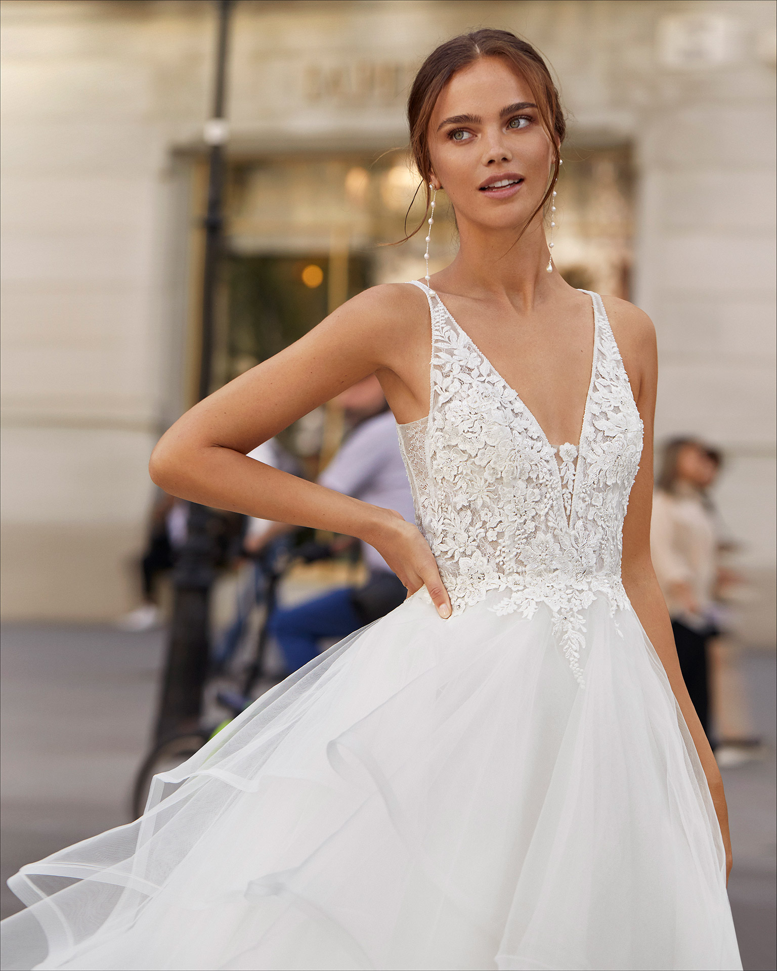 Ballgown-style wedding dress in tulle and beaded lace. With V-neckline and low back. 2021  Collection.
