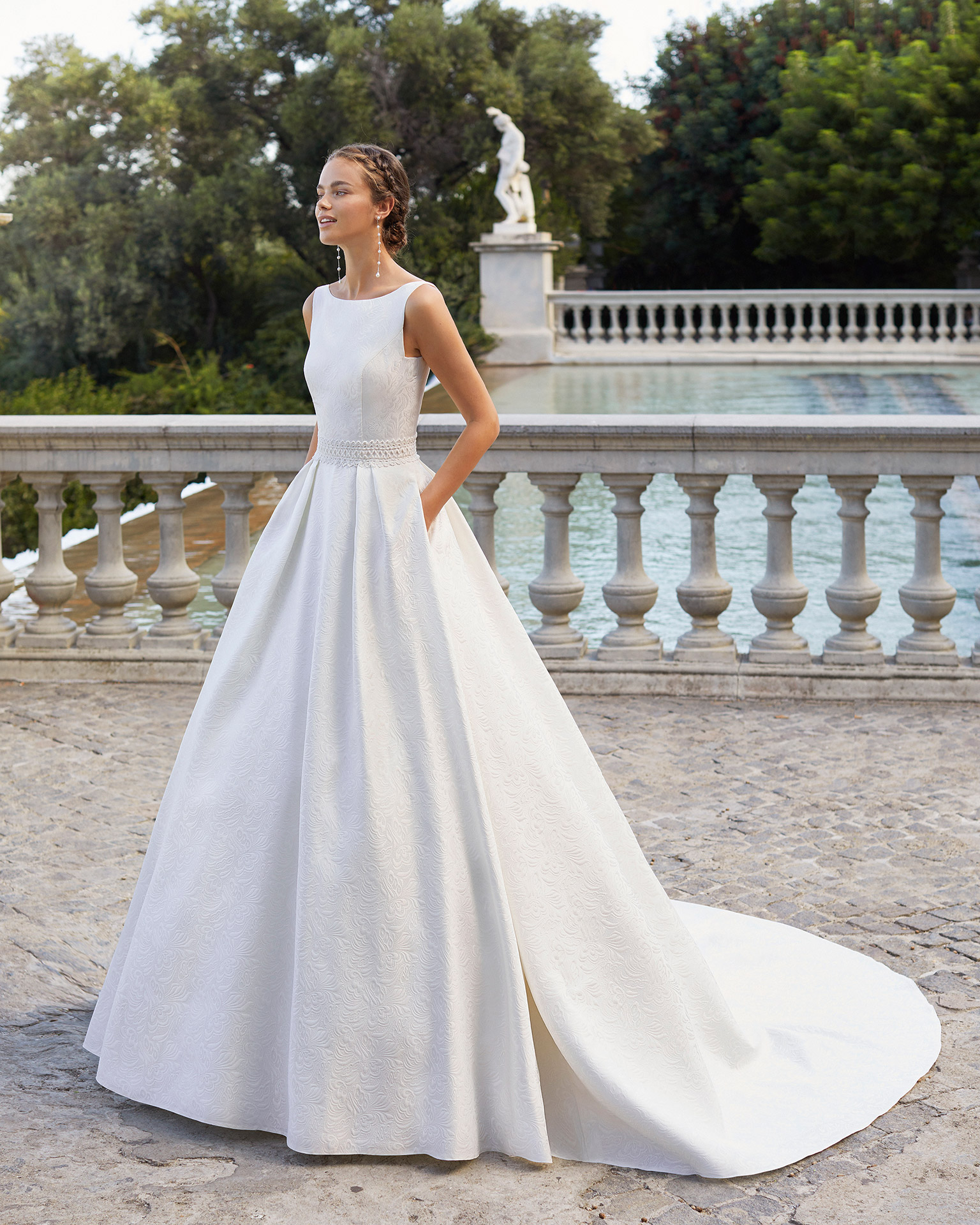 Classic-style wedding dress in brocade with beaded lace on waist. Bateau neckline, V-back and pockets. 2021  Collection.