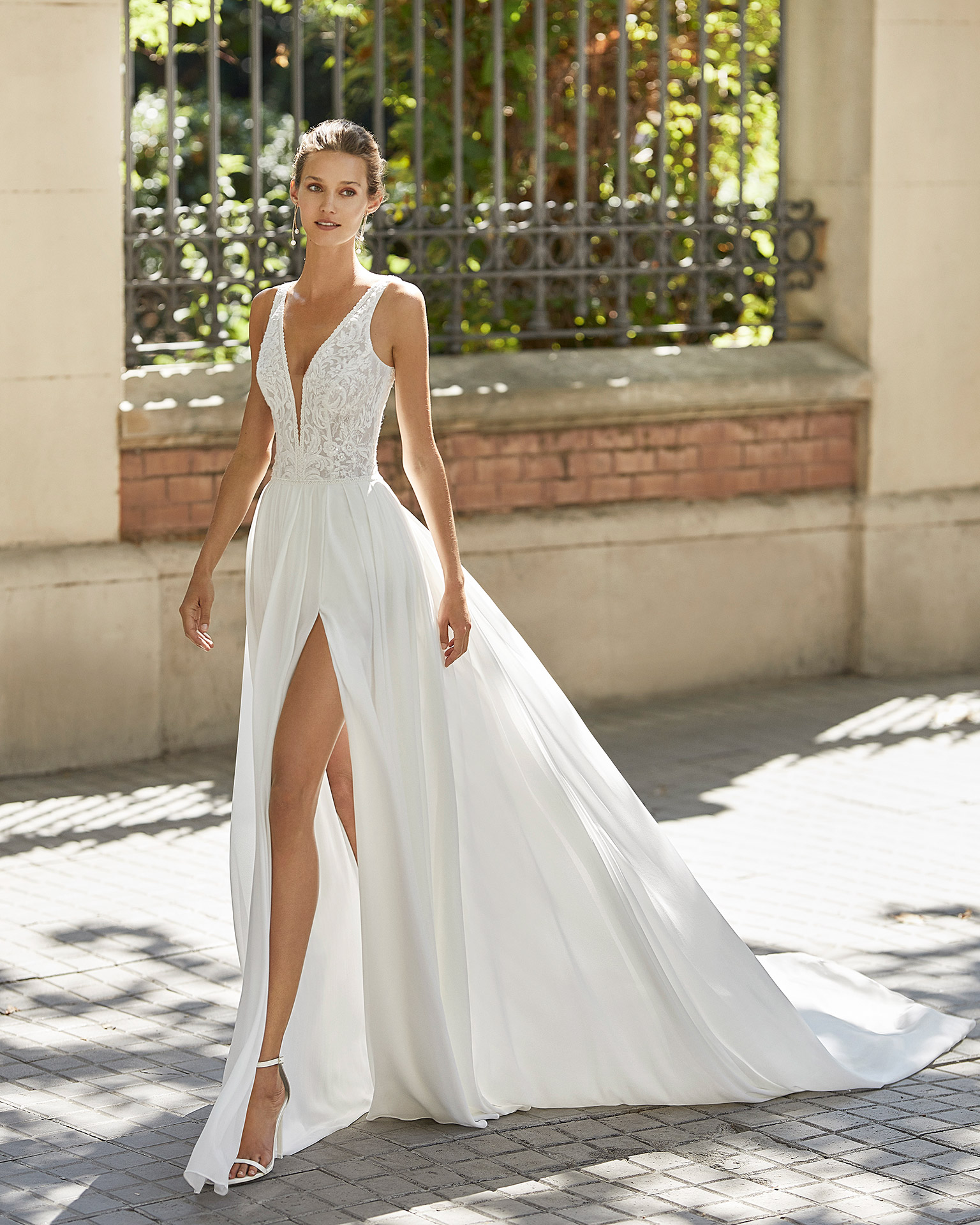 Lightweight wedding dress in georgette and beaded lace. Deep-plunge neckline and V-back. 2022  Collection.