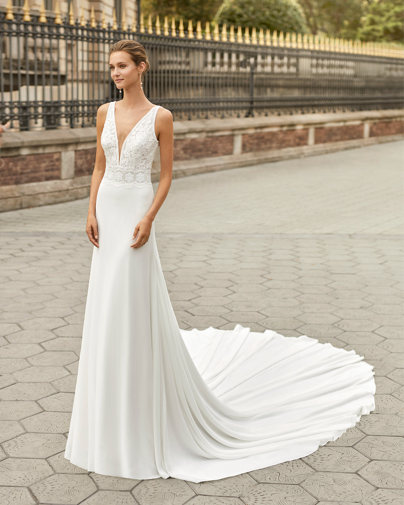 Lightweight wedding dress in georgette and lace. Deep-plunge neckline and V-back. 2022  Collection.