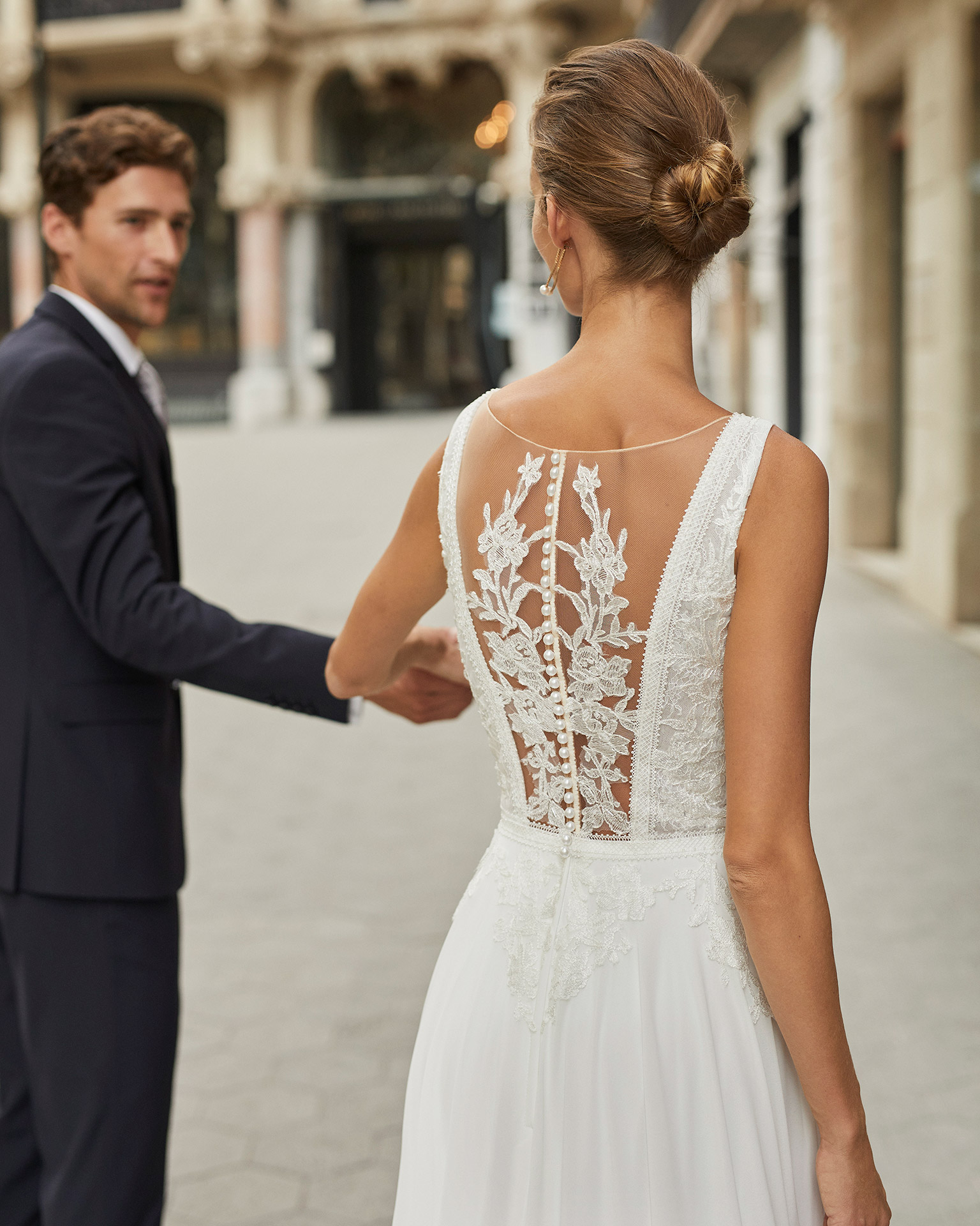 Lightweight wedding dress in georgette and beaded lace. Deep-plunge neckline, square back with lace appliqué. 2022  Collection.
