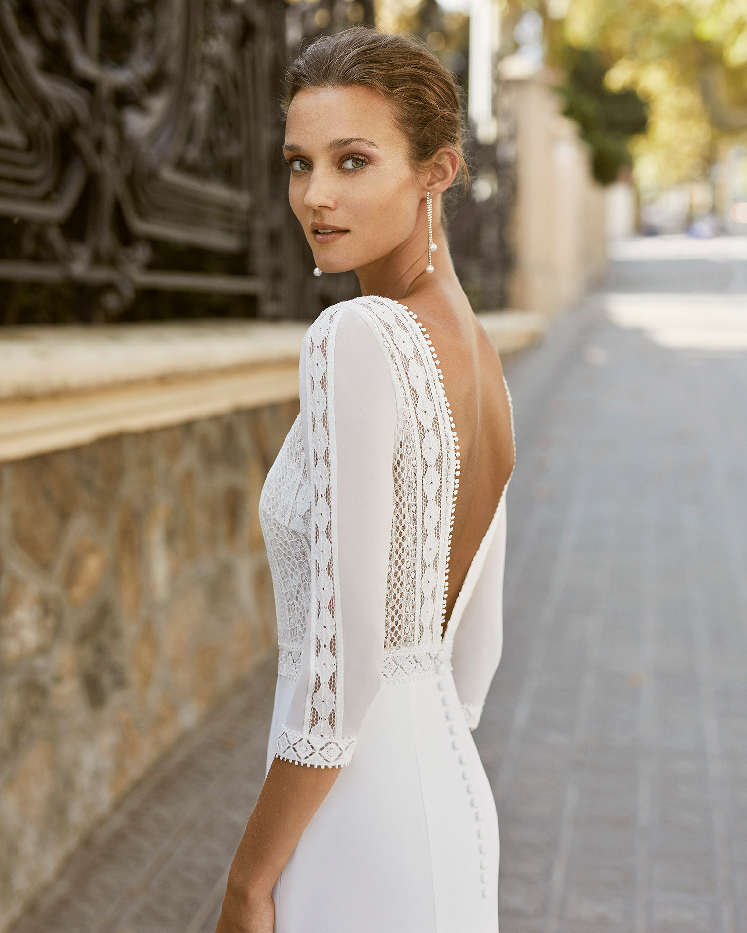 Lightweight wedding dress in georgette with beaded waist. Boat neck, low back and 3/4-length sleeves. 2022  Collection.
