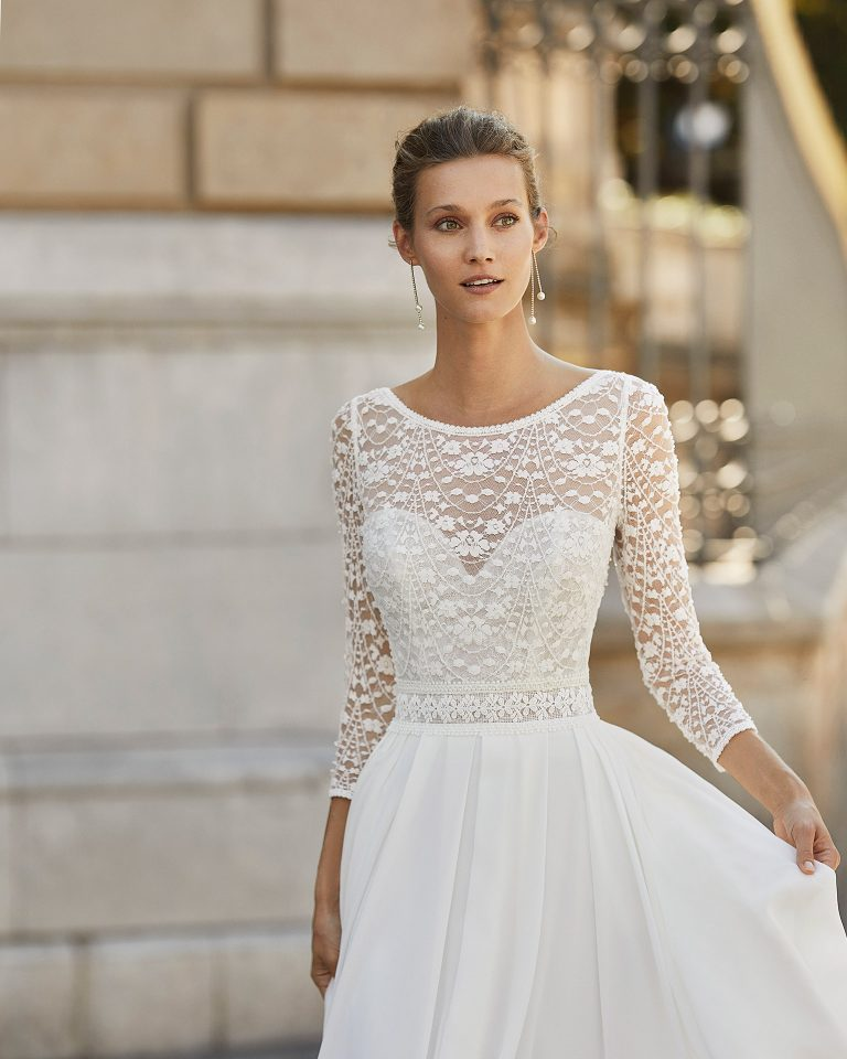 Lightweight wedding dress in georgette and beaded lace. Boat neck, V-back and 3/4-length sleeves. 2022  Collection.