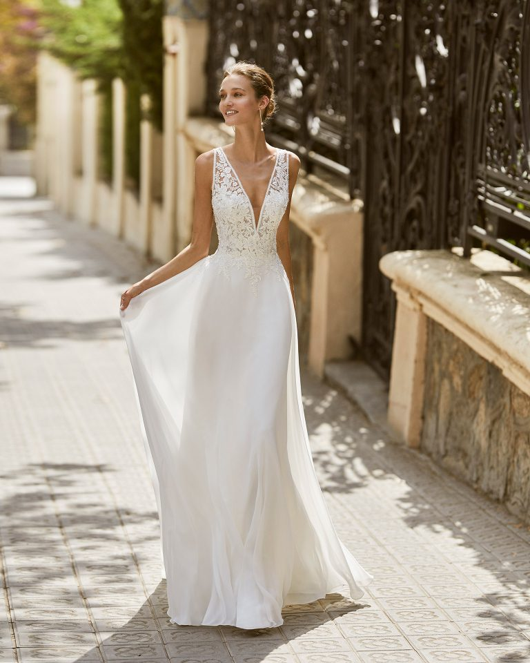 Lightweight wedding dress in voile and beaded lace. V-neck and lace appliqué back. 2022  Collection.