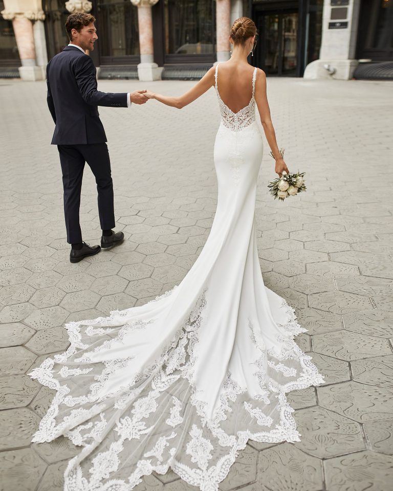 Mermaid wedding dress in stretch crepe with shaping lining and beaded lace. V-neckline and low back. 2022  Collection.