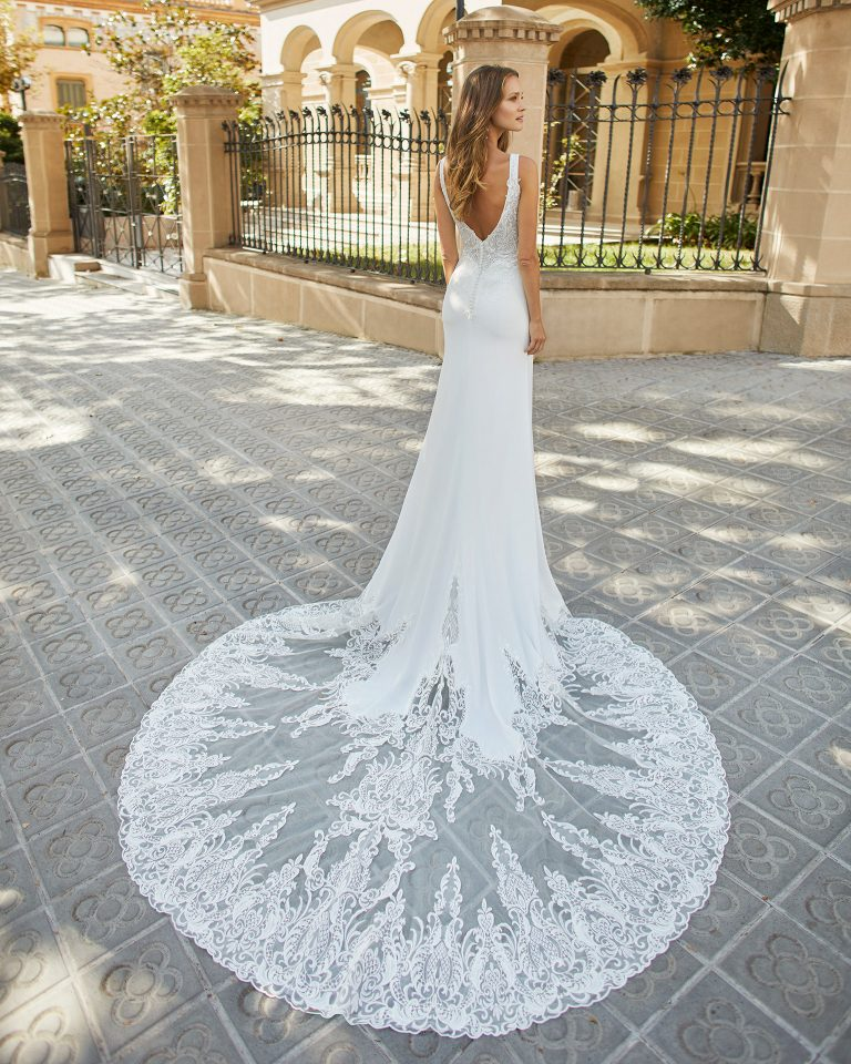 Sheath wedding dress in stretch crepe with shaping lining and lace. Deep-plunge neckline and low back. 2022  Collection.